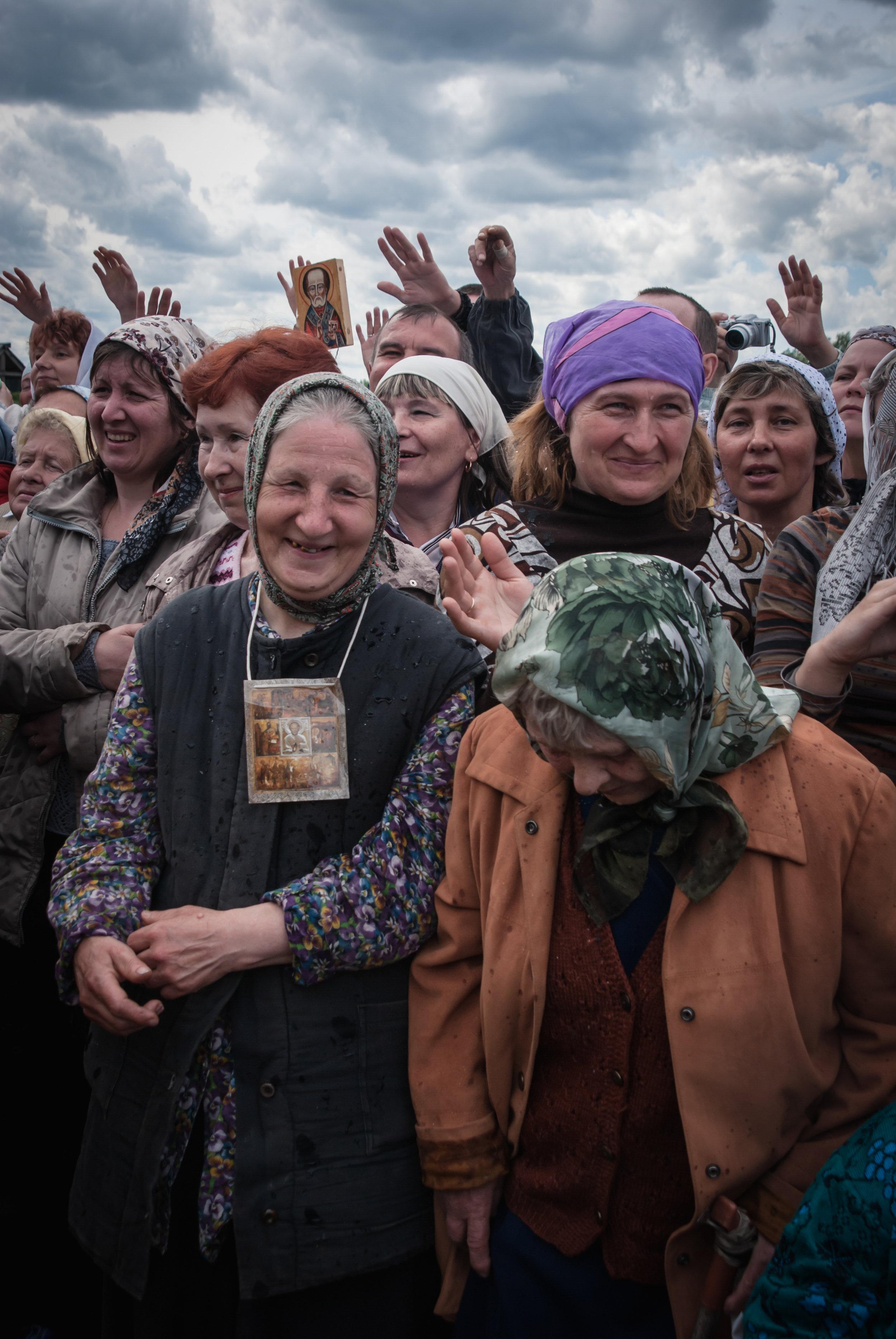 Velikoretskoye pilgrims being sprinkled with holy water, Kirov region June 2009