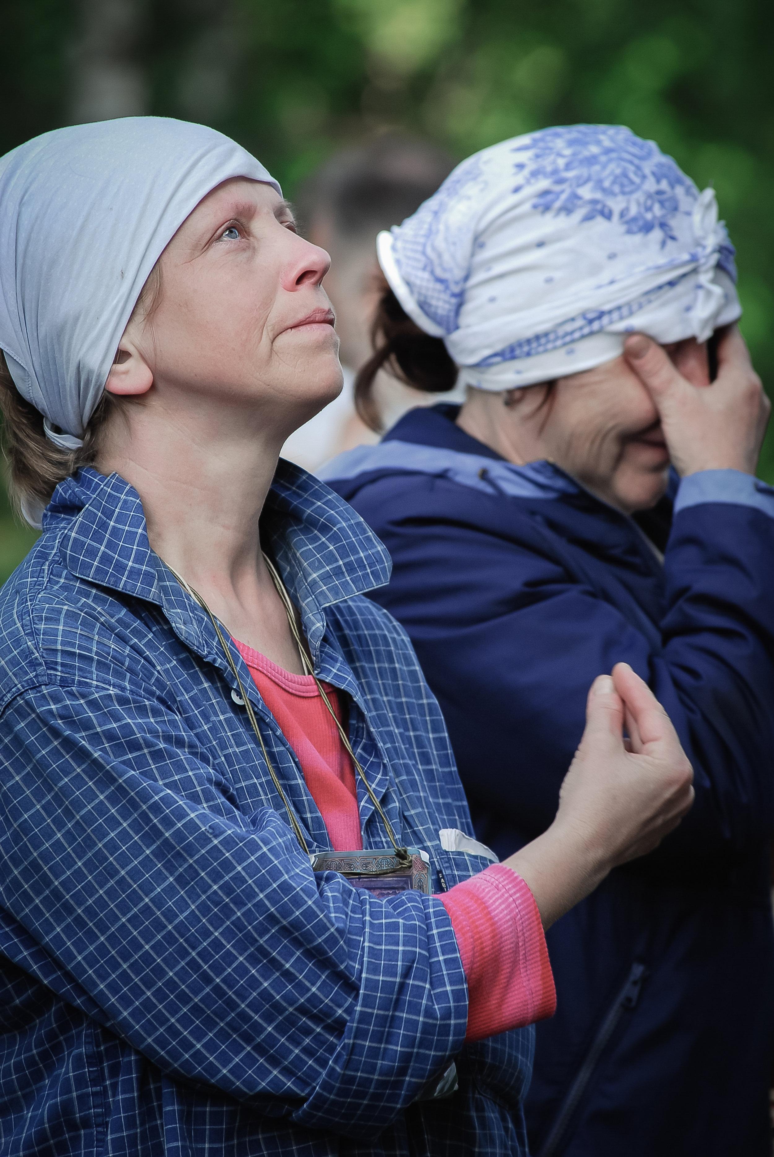 Pilgrims praying before a damaged fresco of the Mother of God, Kirov region, June 2010