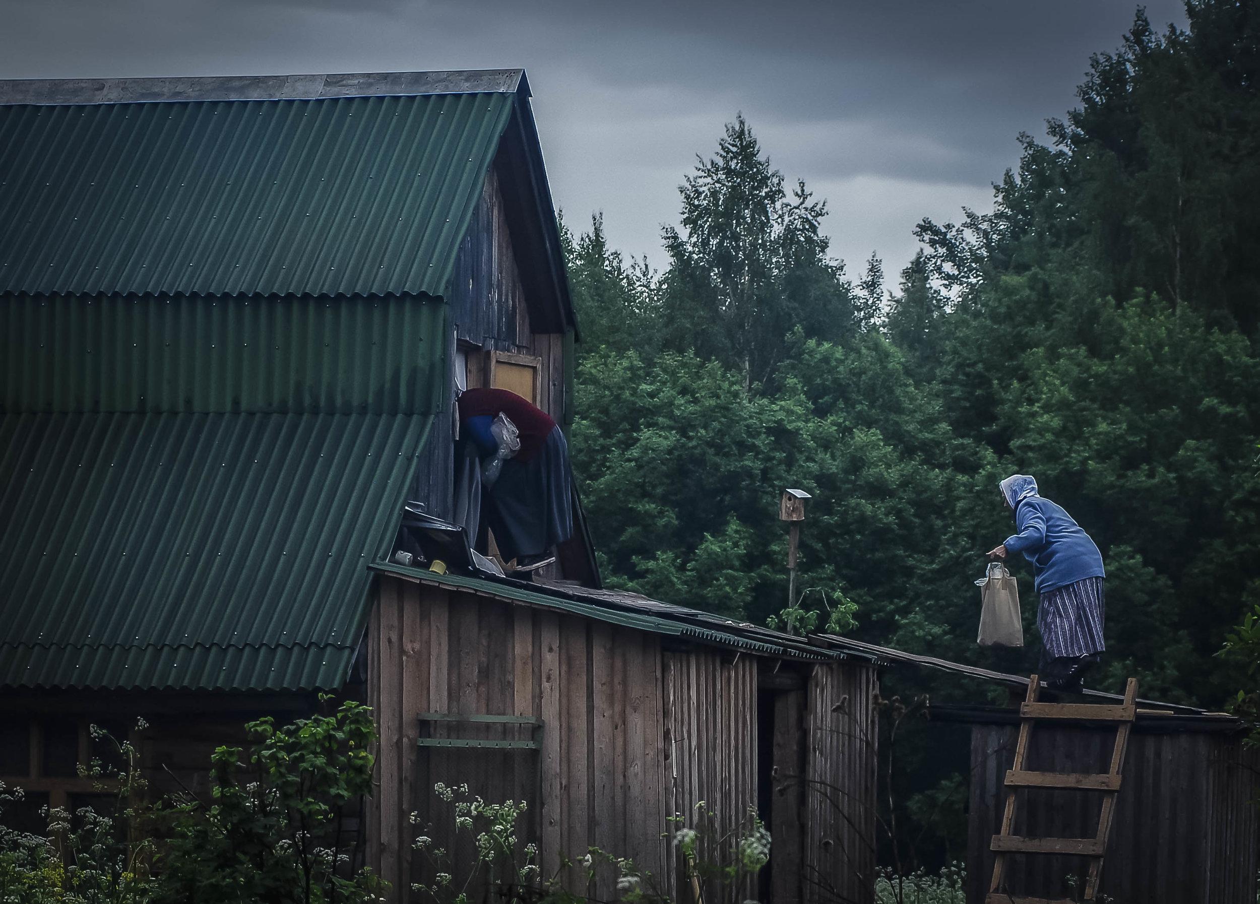 Pilgrims climbing into a hayloft to rest, Goroxovo, June 2010