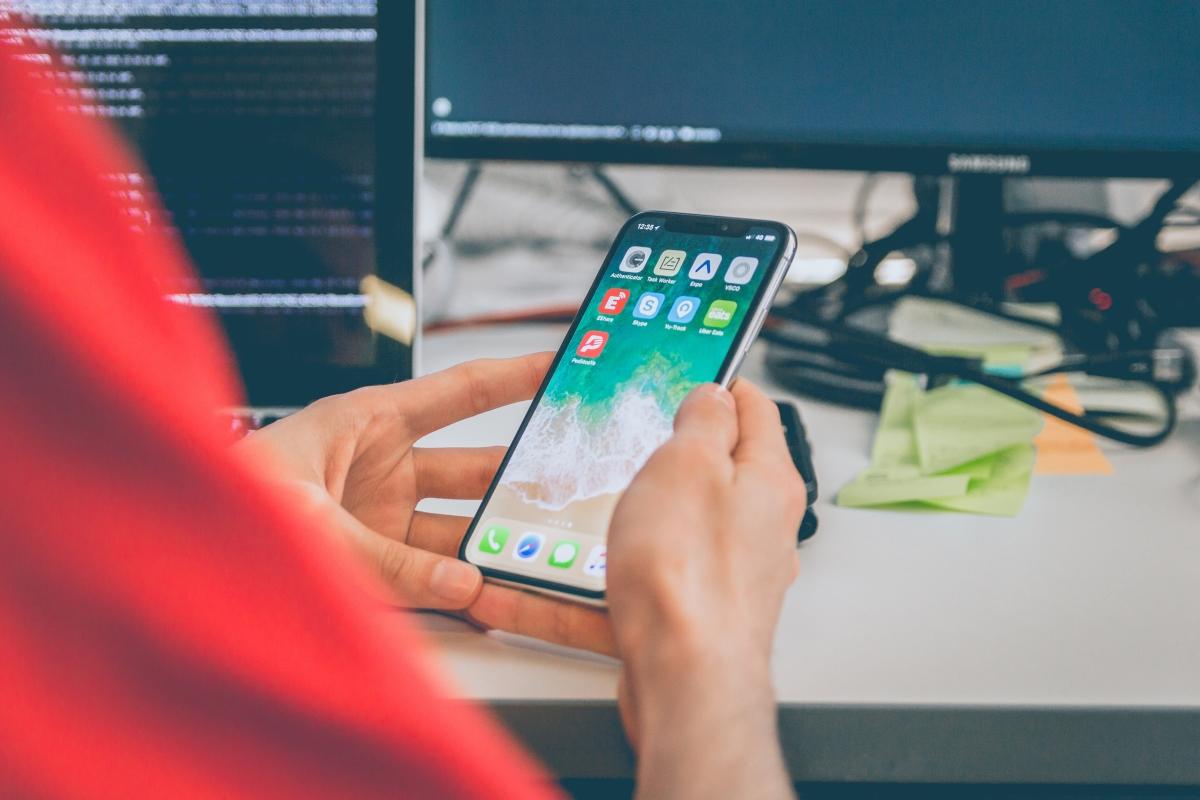 Mobile App Developer Holding a Mobile Phone