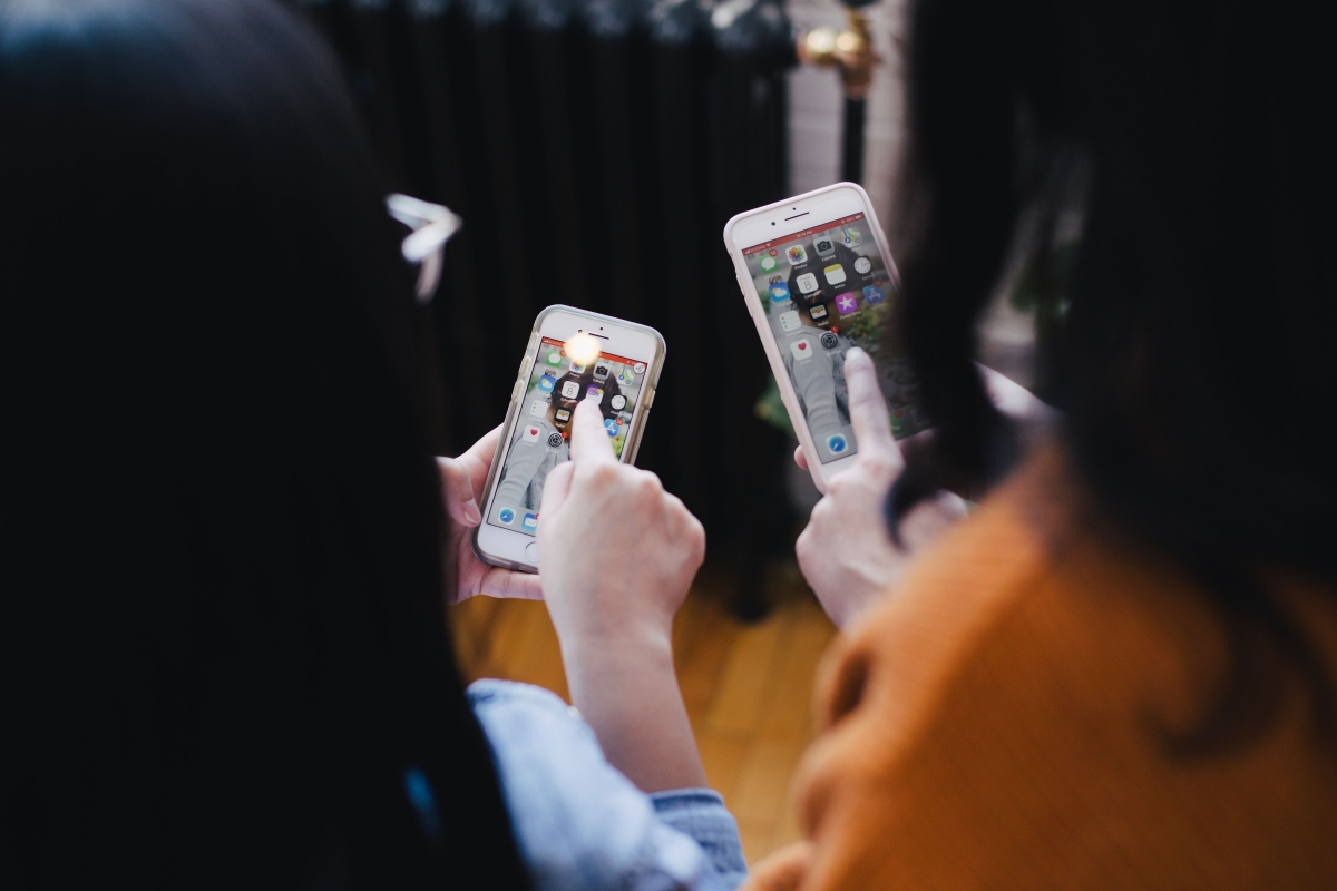 Two Women Testing Mobile Apps on Their Smartphones