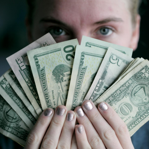 Woman Holding Lots of Cash