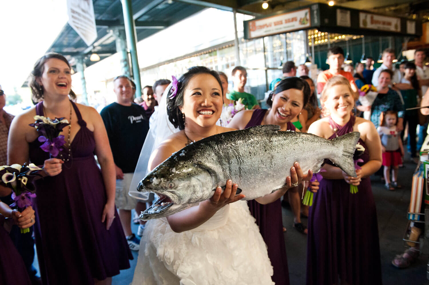 bride-catches-fish-pike-place-market.jpg