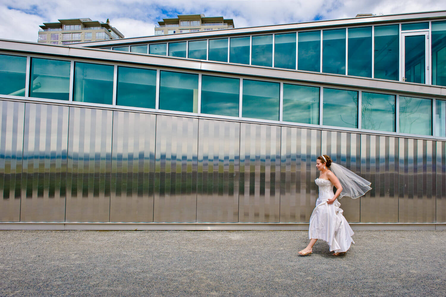 bride-walks-past-silver-wall.jpg