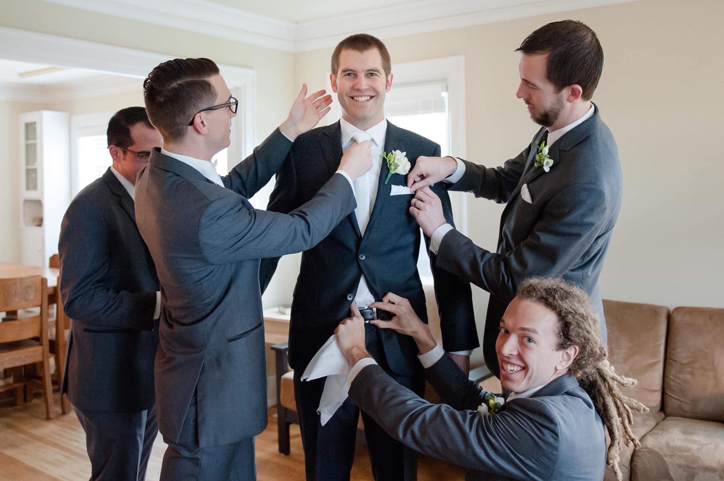 groomsmen-helping-groom.jpg