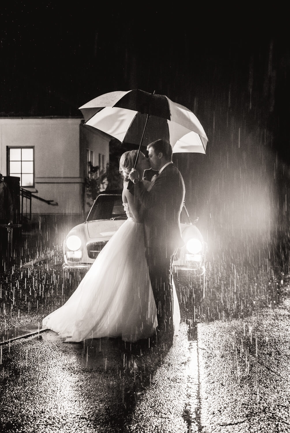 wedding-kiss-rain-headlights.jpg