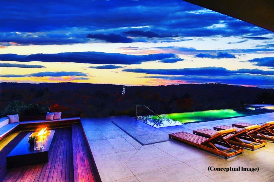 LOunge area with firepit and infinity edge pool looking into THE stEEPLE of hilltop Presbyterian Church