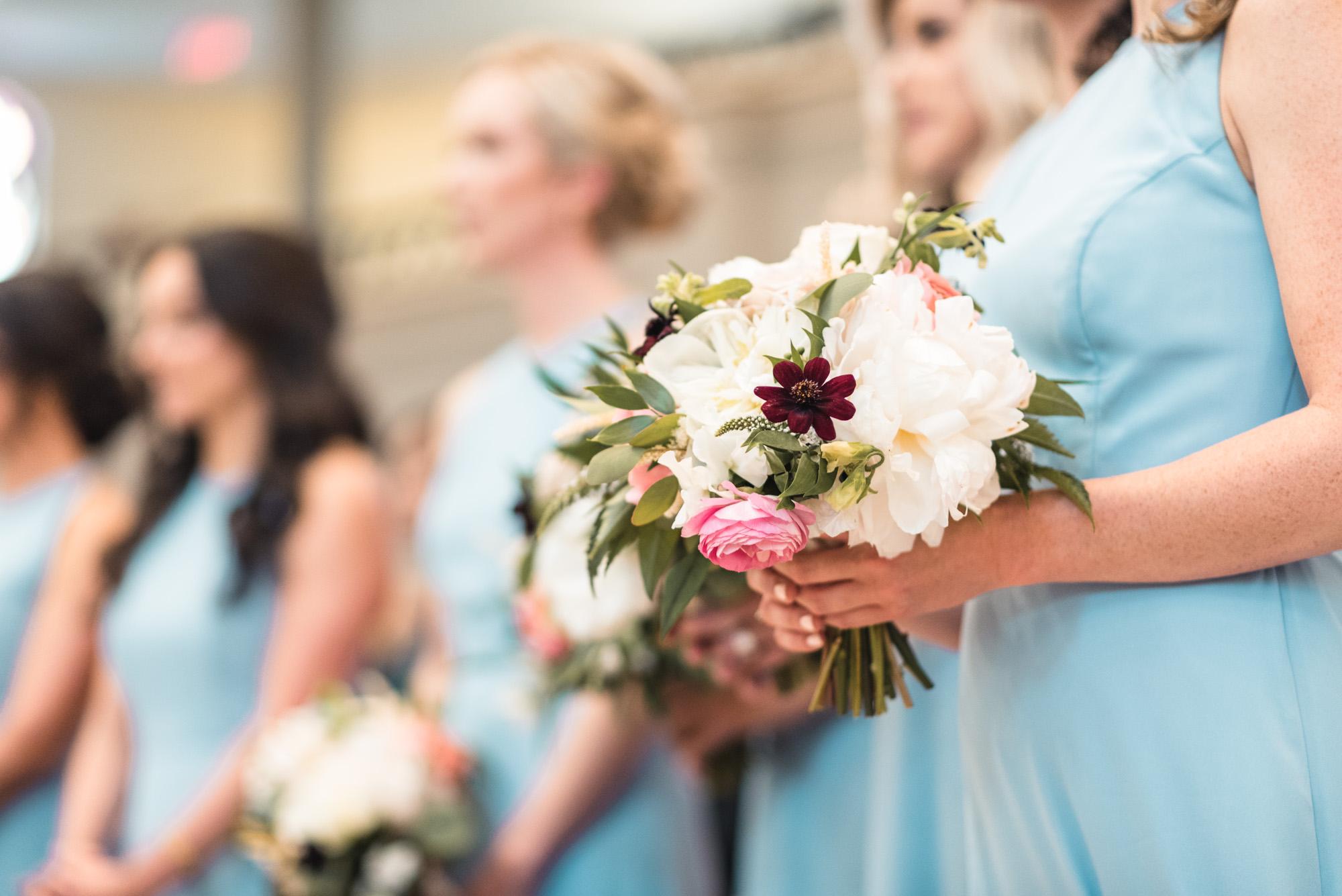 Bridesmaids bouquet at ceremony
