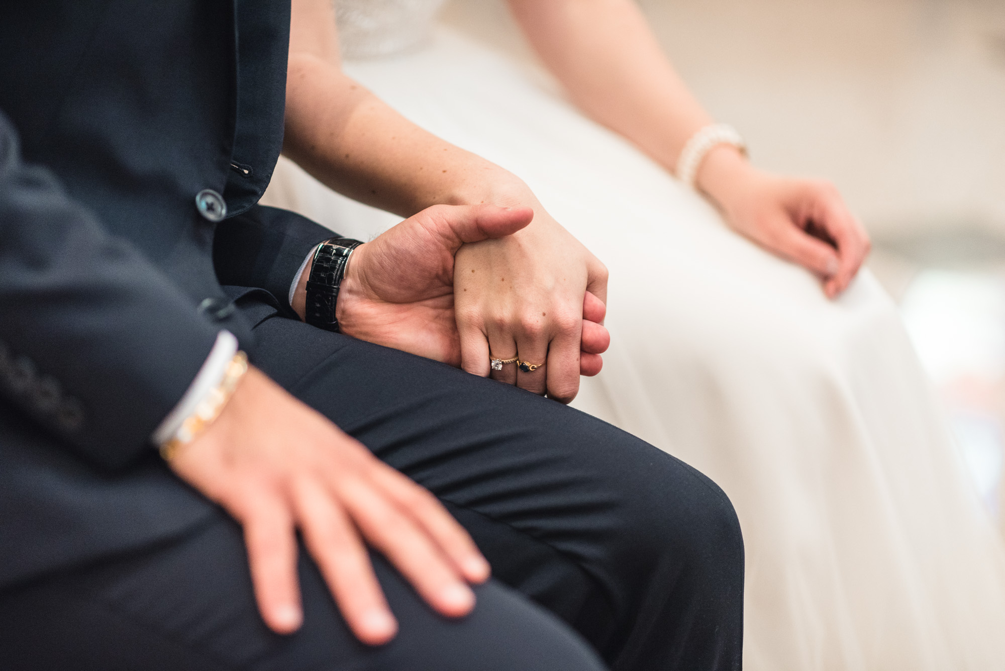 Bride and Groom hold hands at ceremony