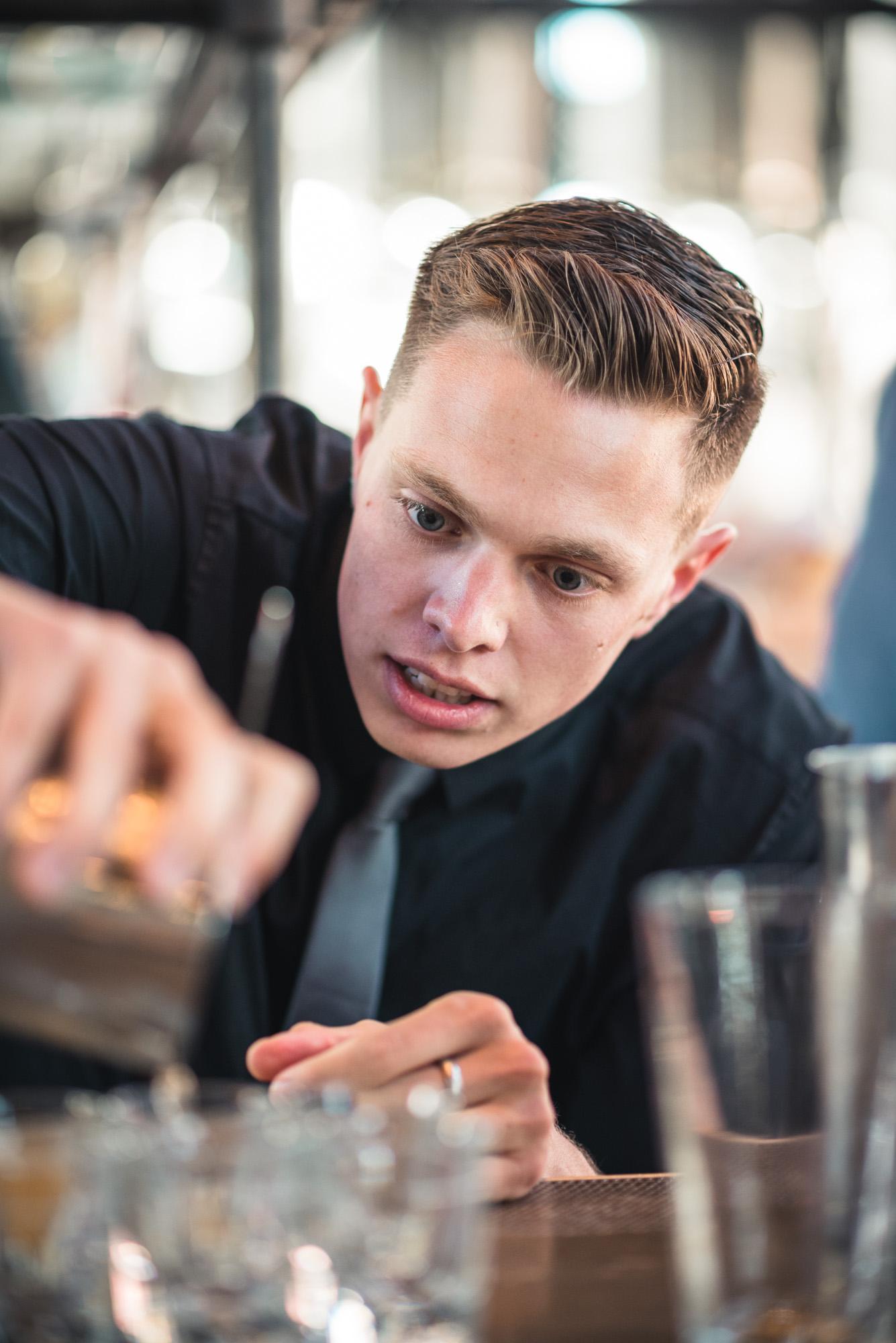 Bartender making shots at the bar