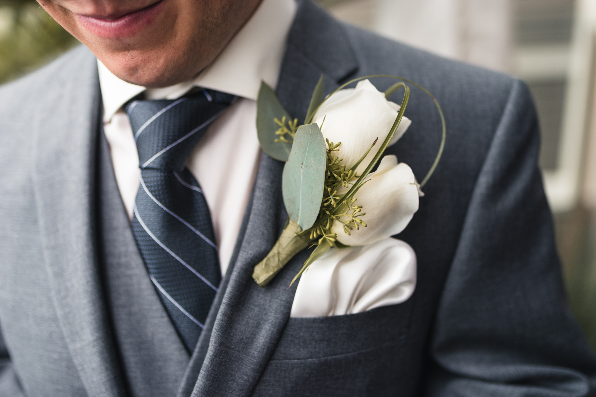 Groom's clothing details