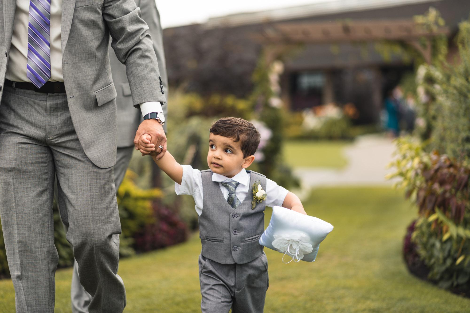 Ring bearer walking with dad