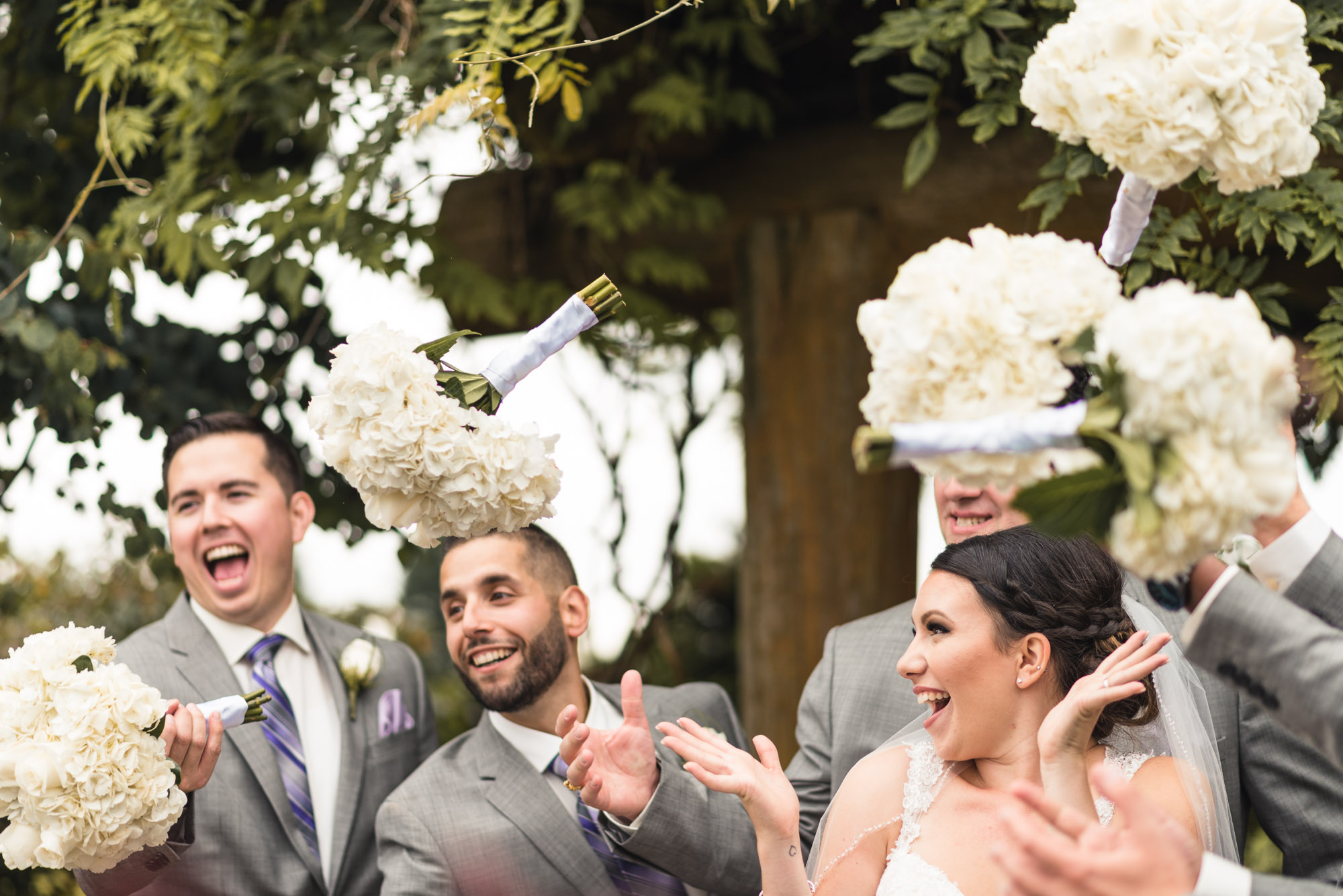 Groomsmen and Bride tossing bouquets