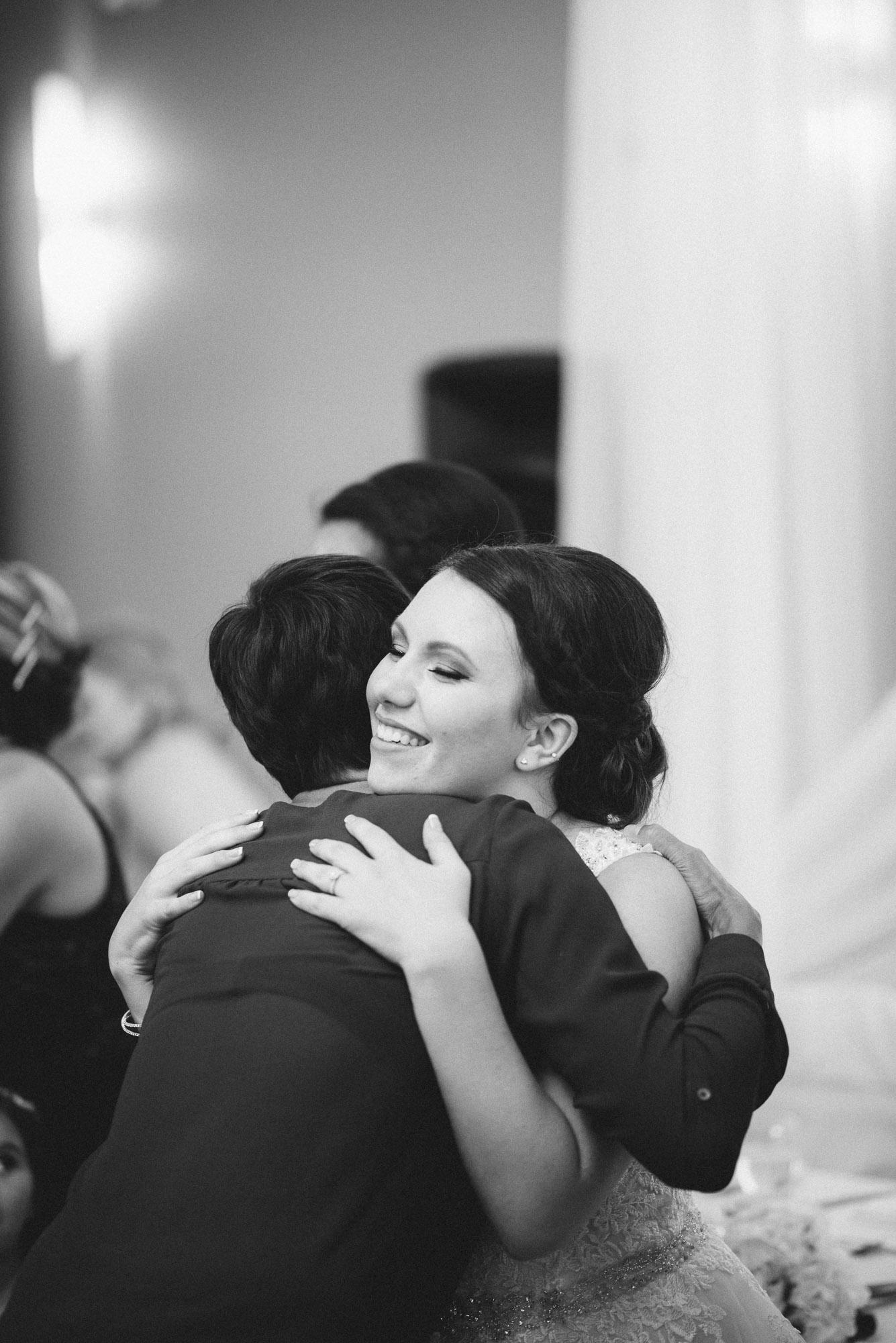 Bride hugs guest at receiving line
