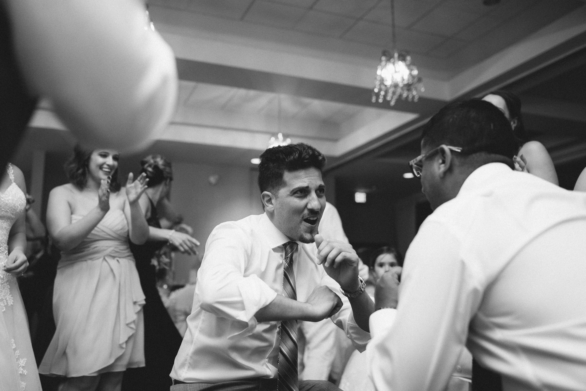 Guest dancing at reception black and white