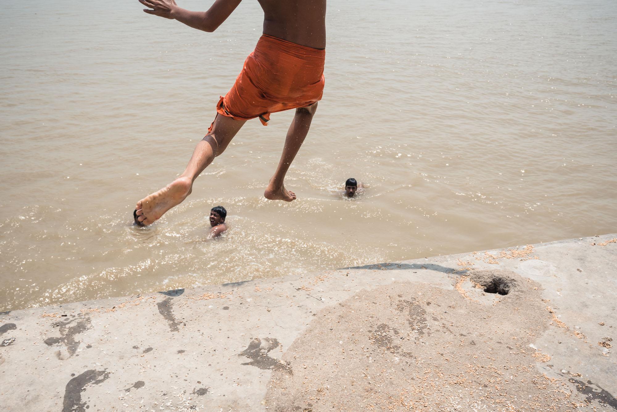 Boys jumping into the Ganges in Varanasi