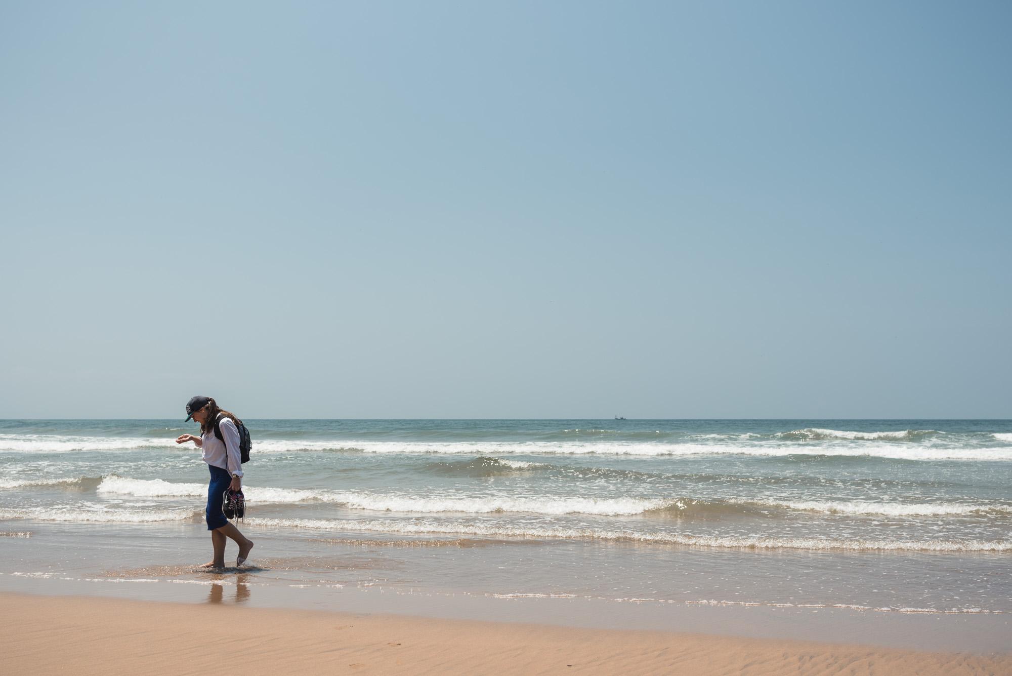 Woman walking at Bogmalo Beach in Goa