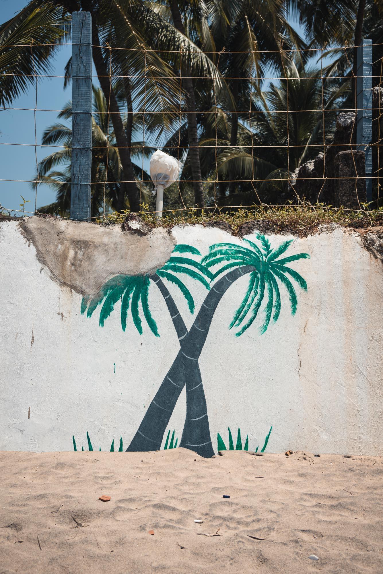 Palm tree mural at Bogmalo Beach in Goa
