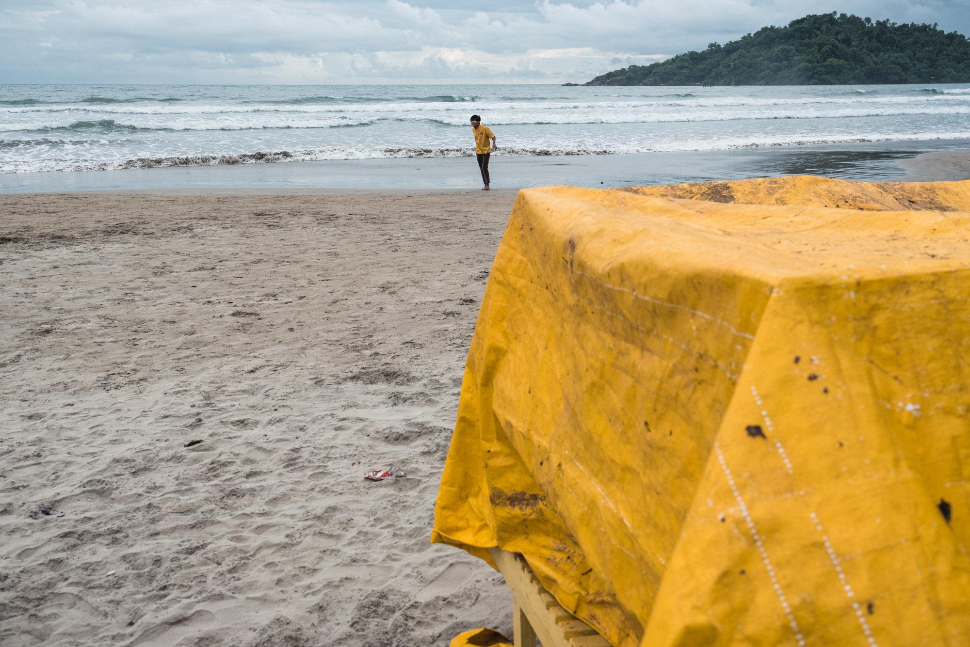 Man standing in yellow at Fishing at Palolem Beach, Goa
