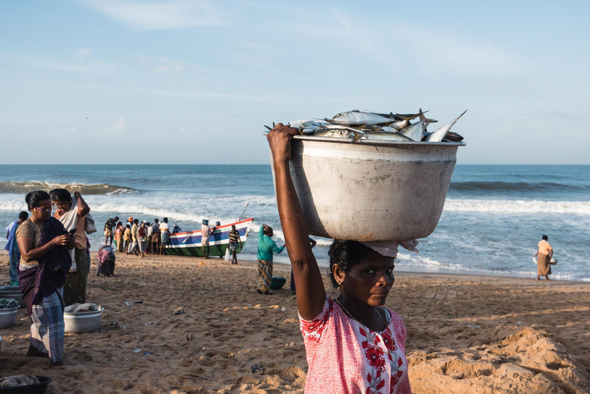 Woman with fish Christian Fishing Village, Varkala