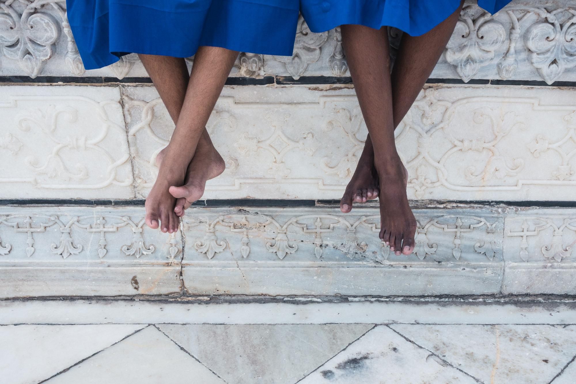 Sitting girl's feet at the Taj Mahal