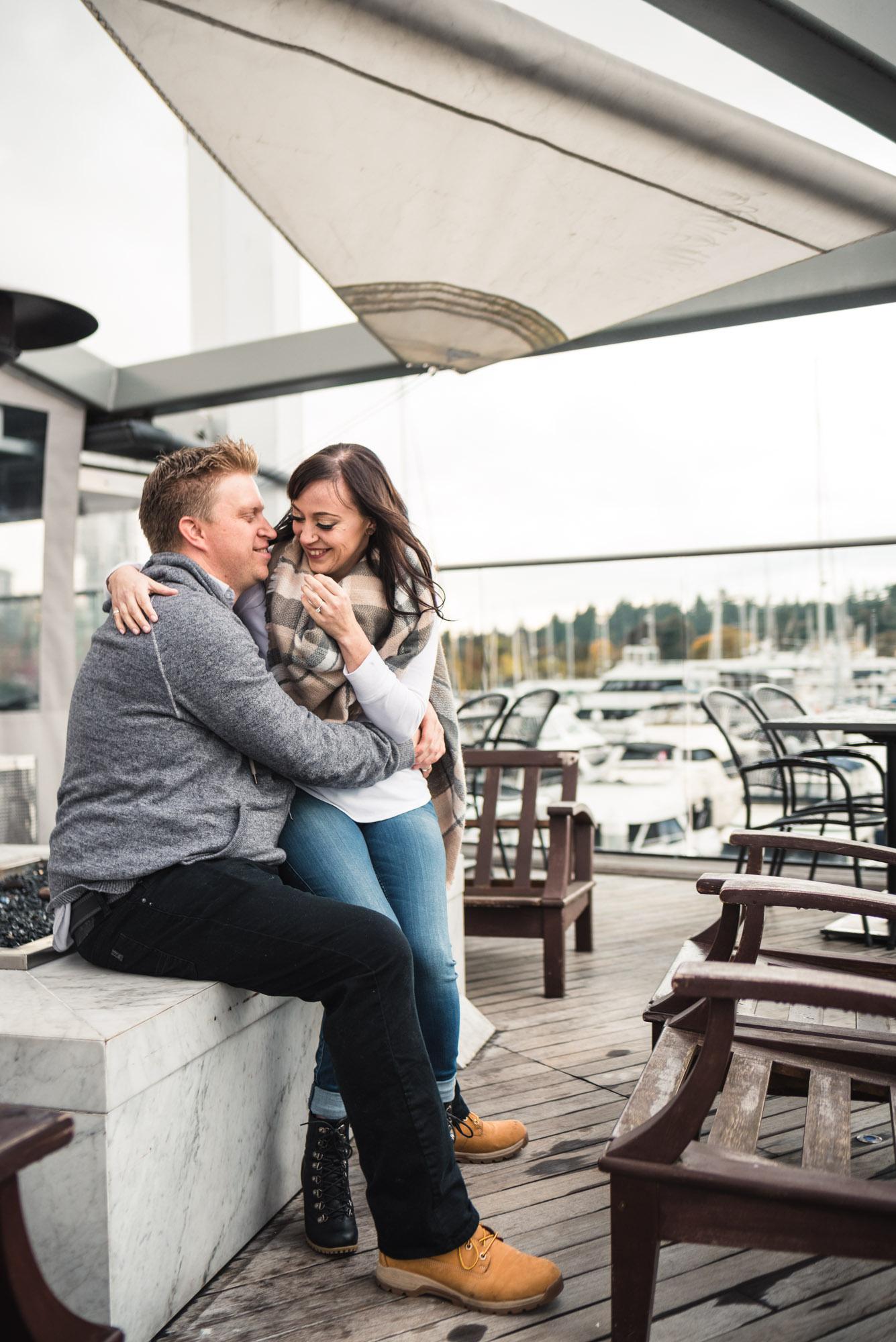 Couple hugs on patio