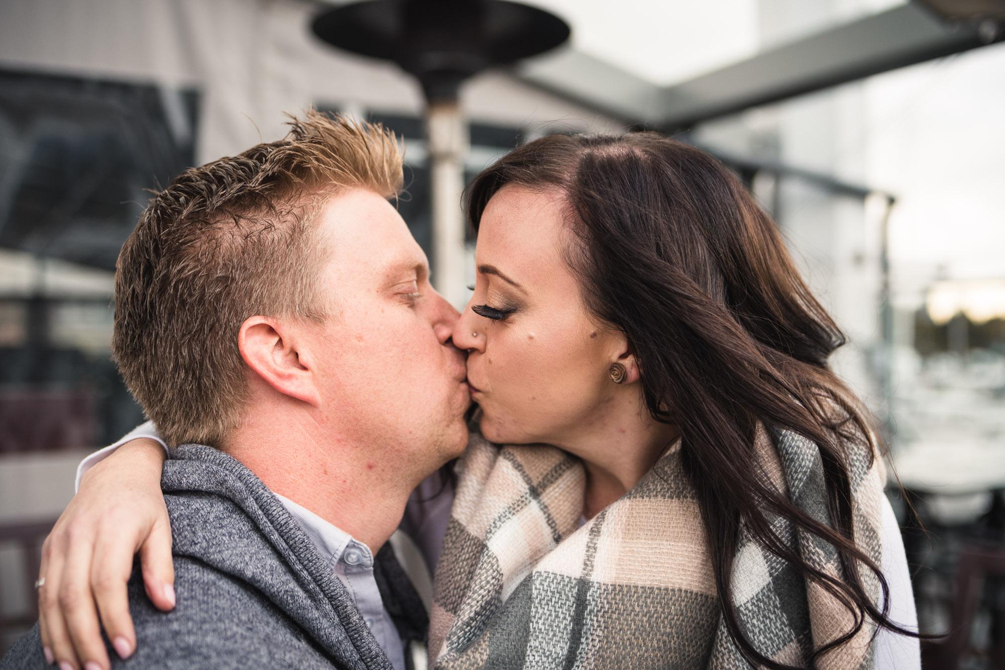 Couple kiss on patio