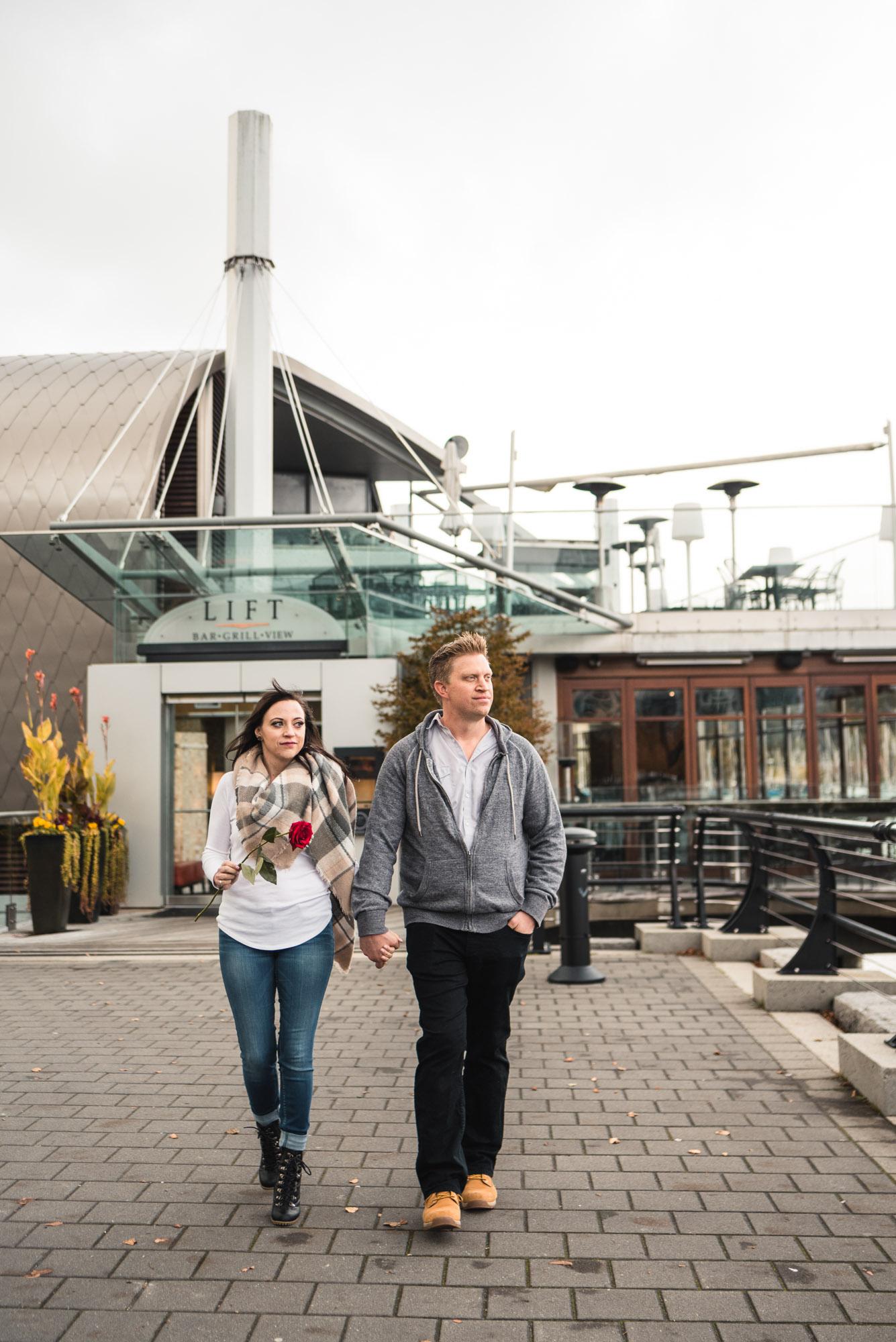 Couple walking down seawall