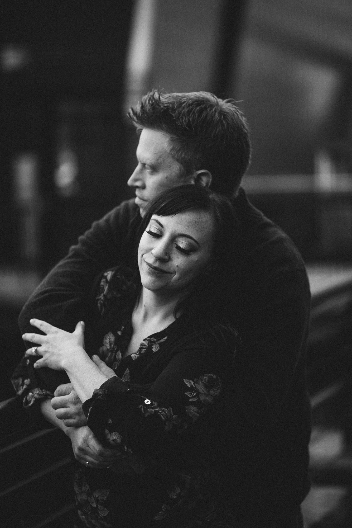 Couple hugs on seawall