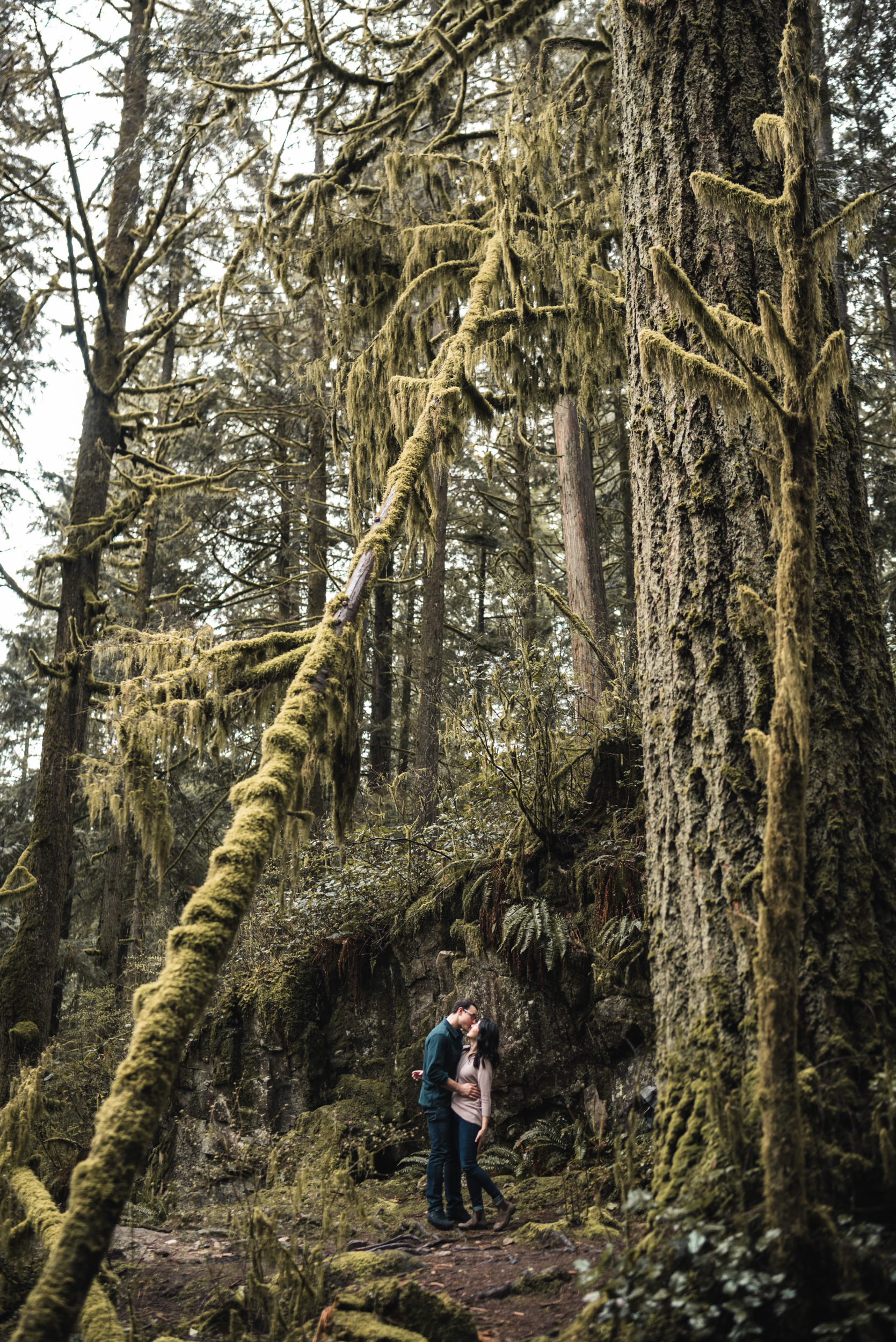 Couple kissing in forest