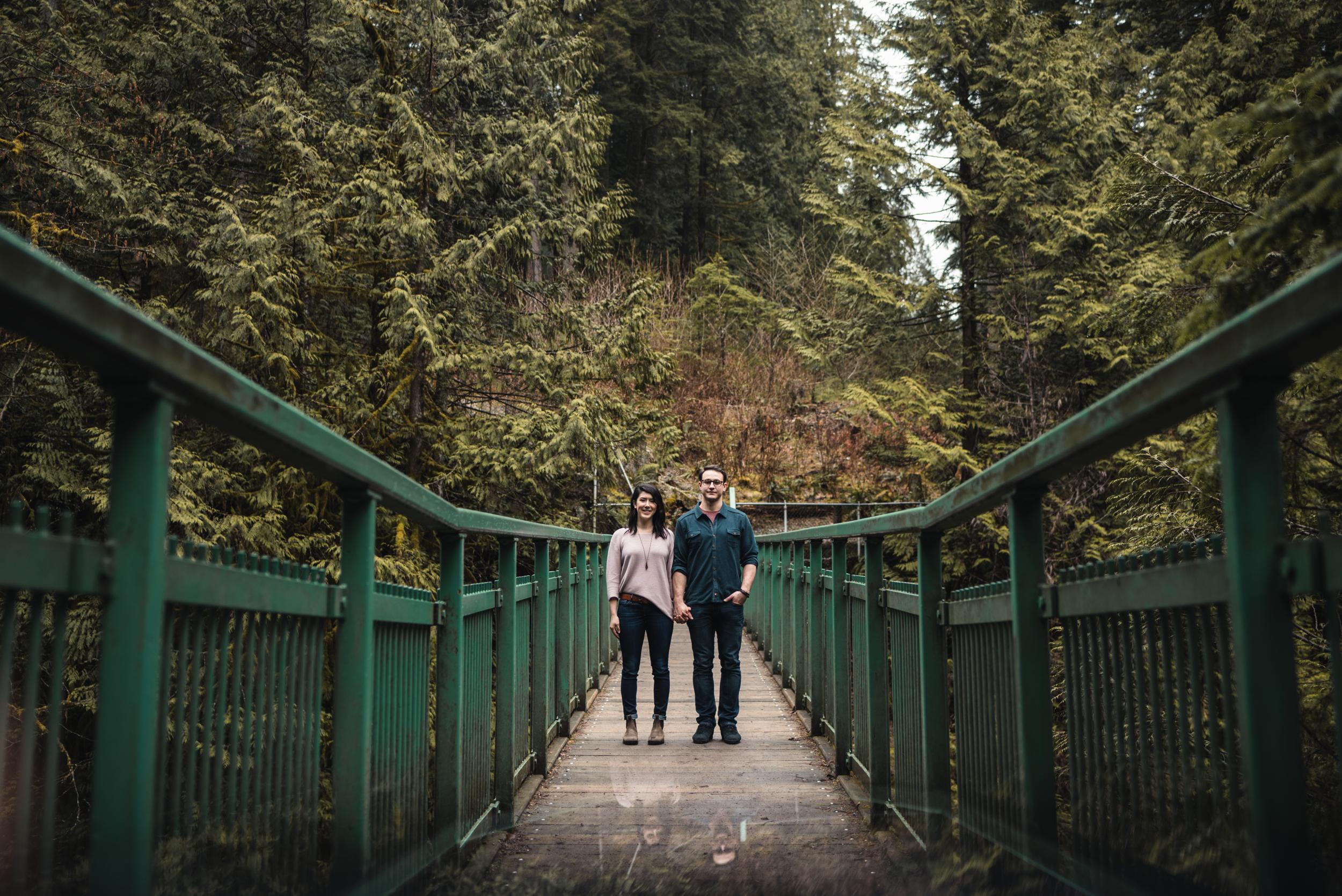 Couple holding hands on bridge