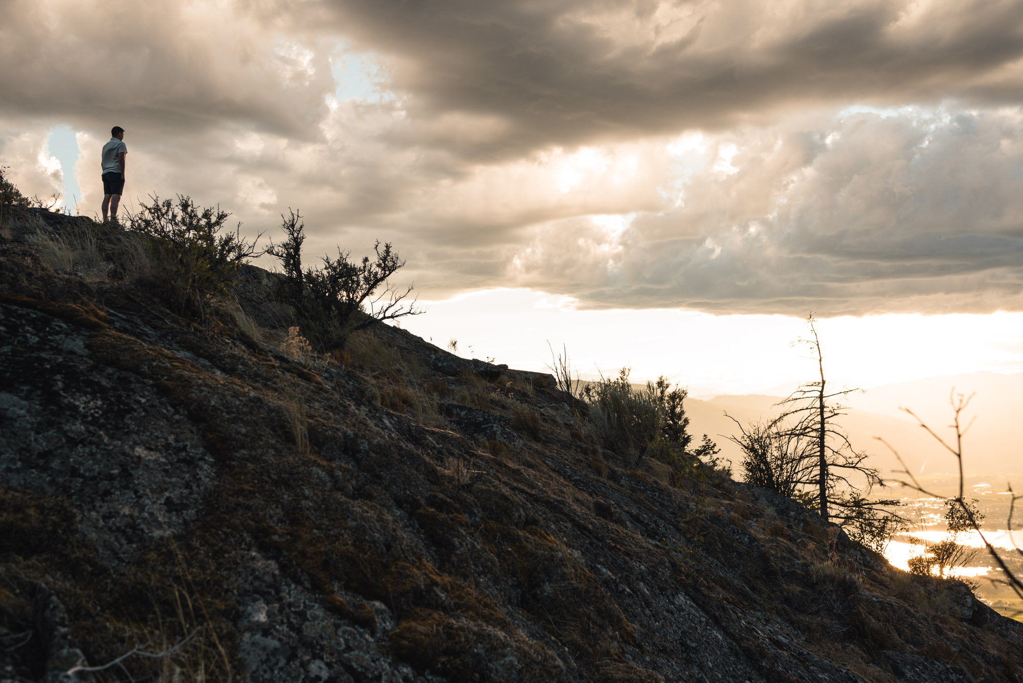 Man stands with sunset on Anarchist Mountain, Osoyoos