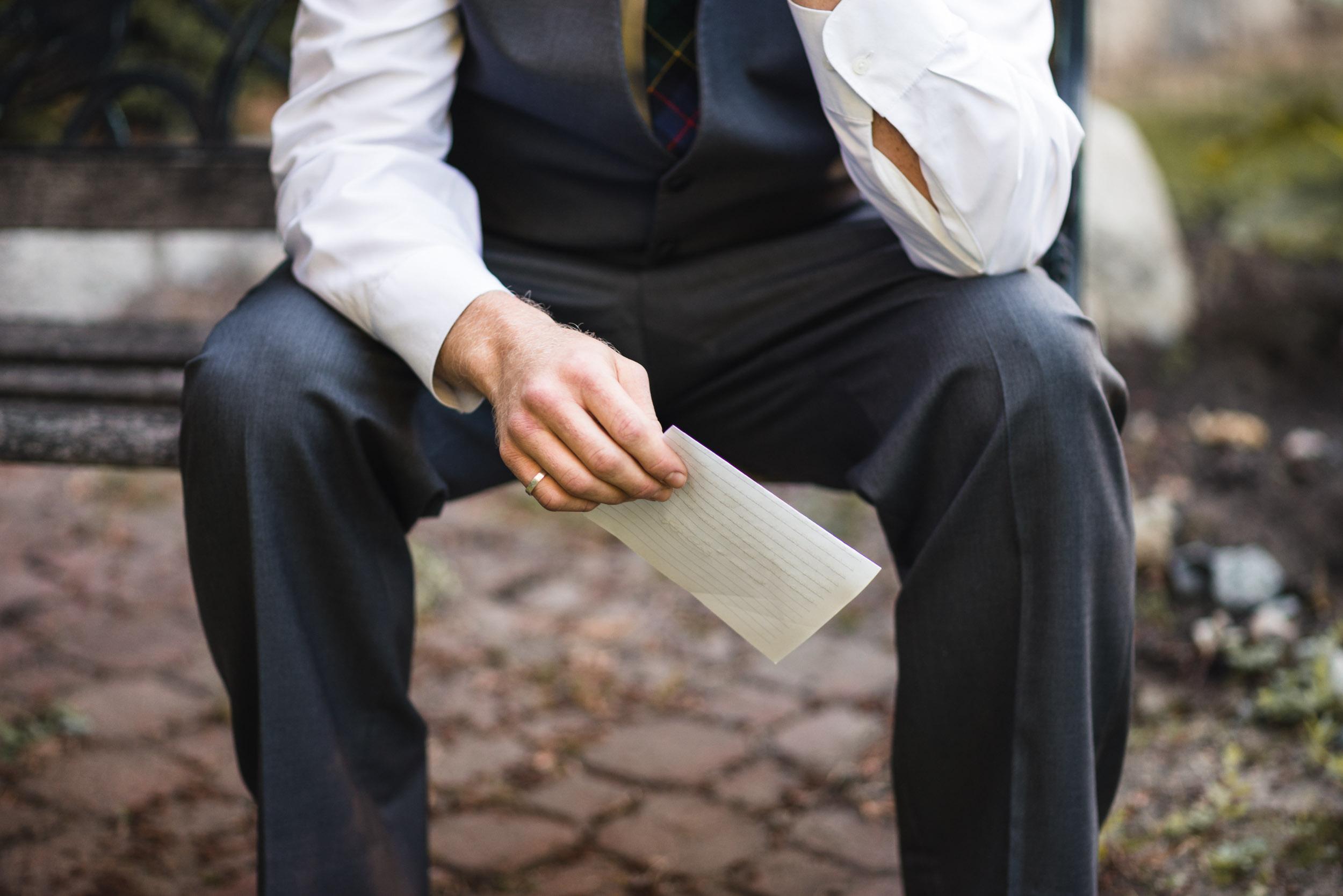 Groom holding letter