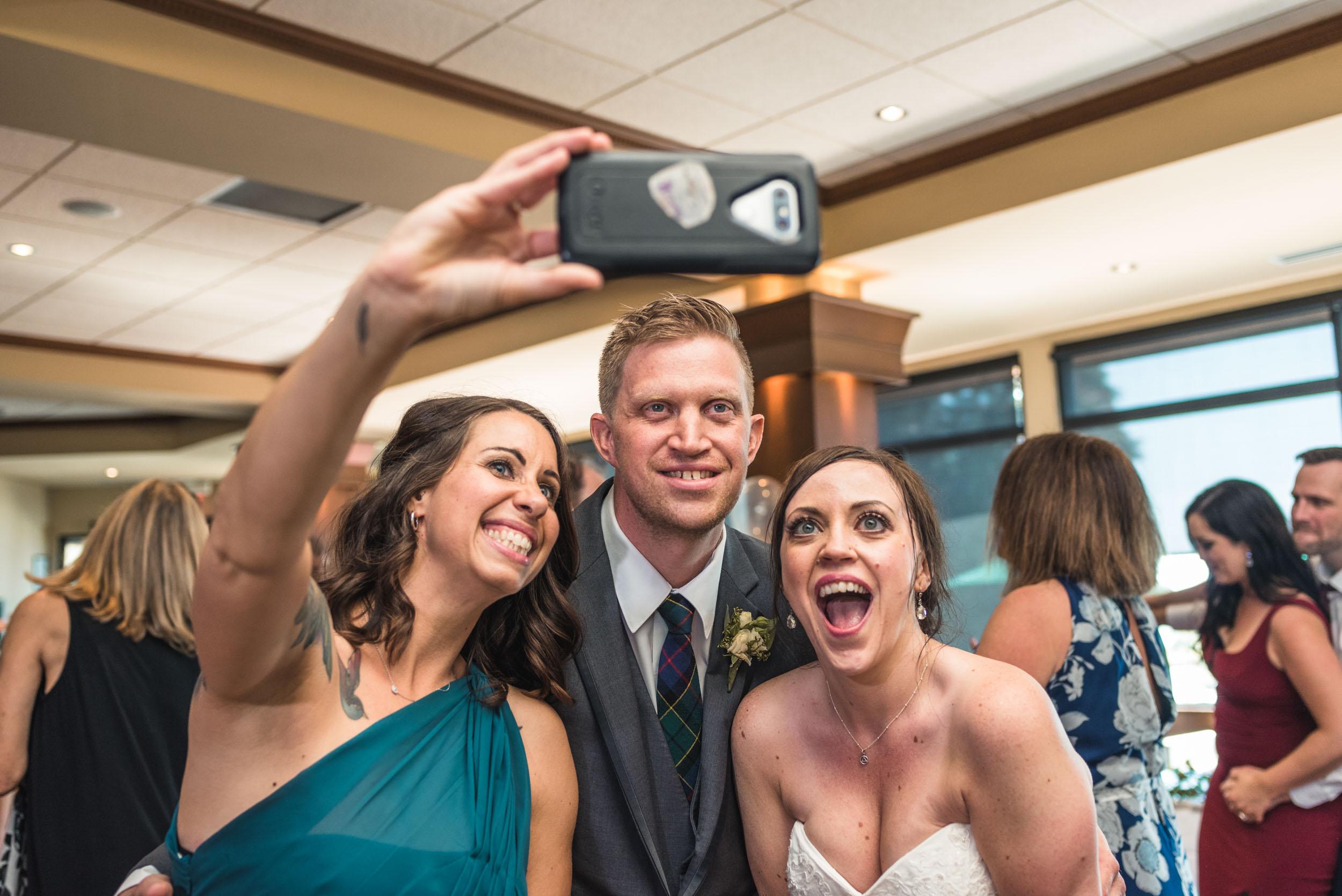 Bride, Groom and Maid of Honour take a selfie