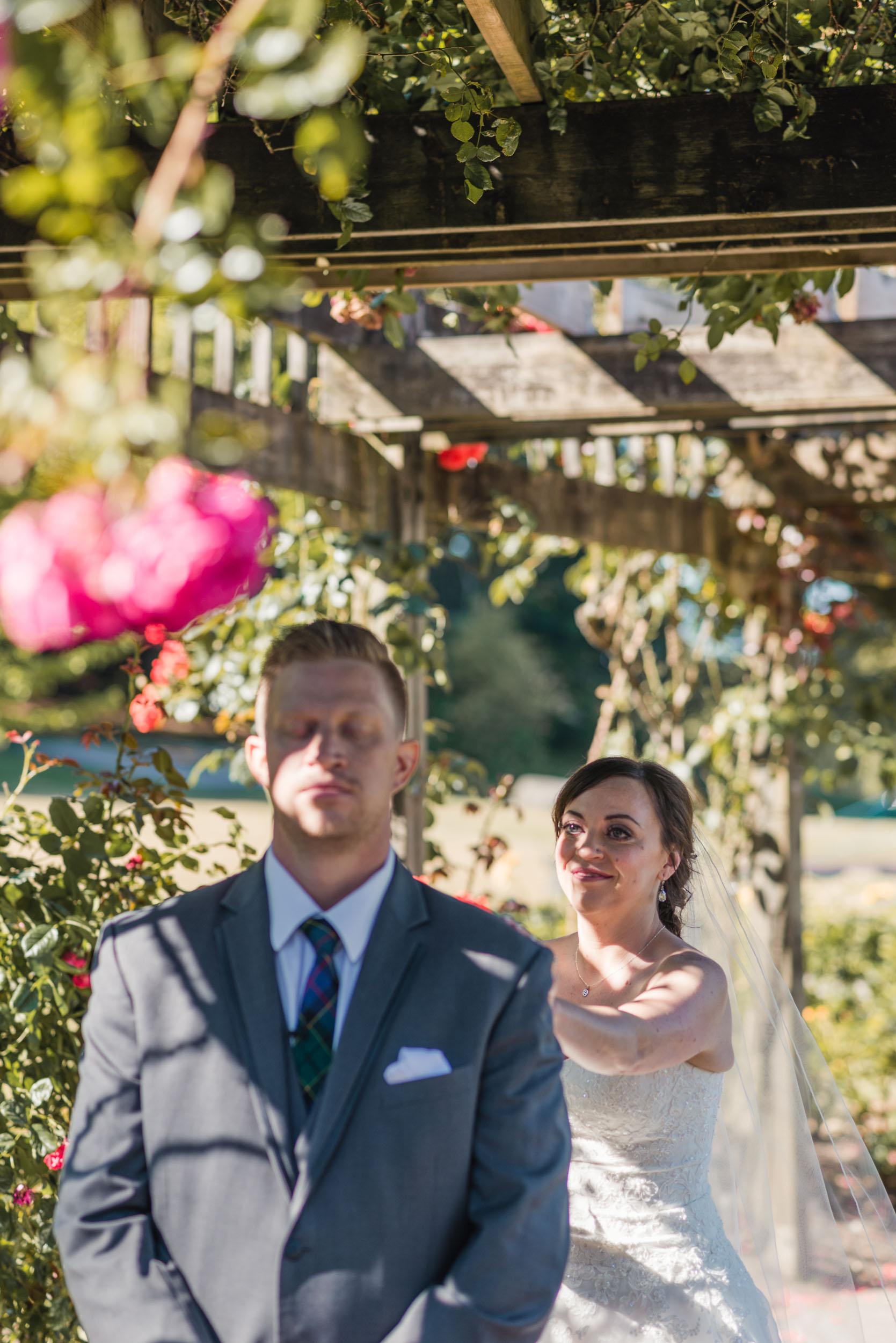 First look Bride and Groom in rose garden