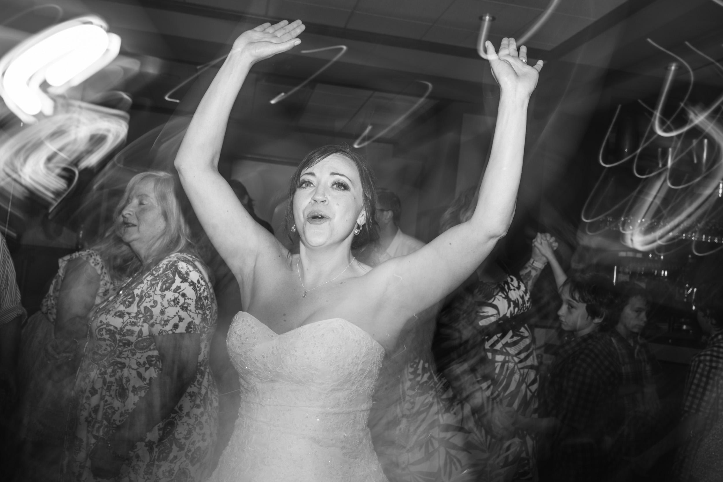 Bride dancing with lights