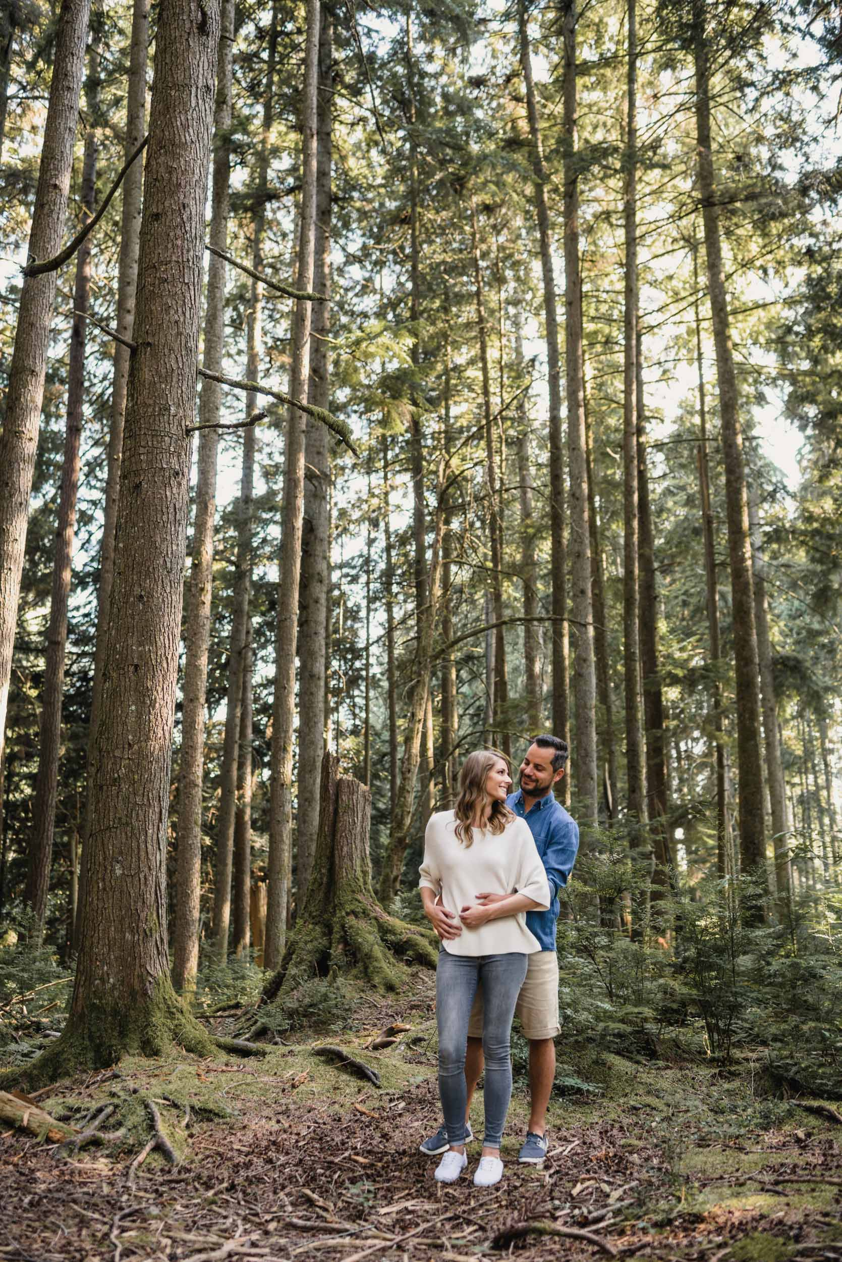 Couple embraces in the forest