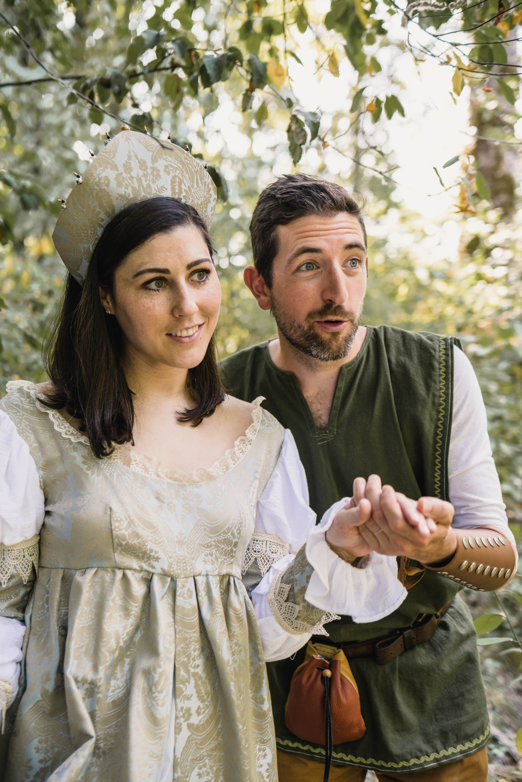 Couple with medieval costumes in forest