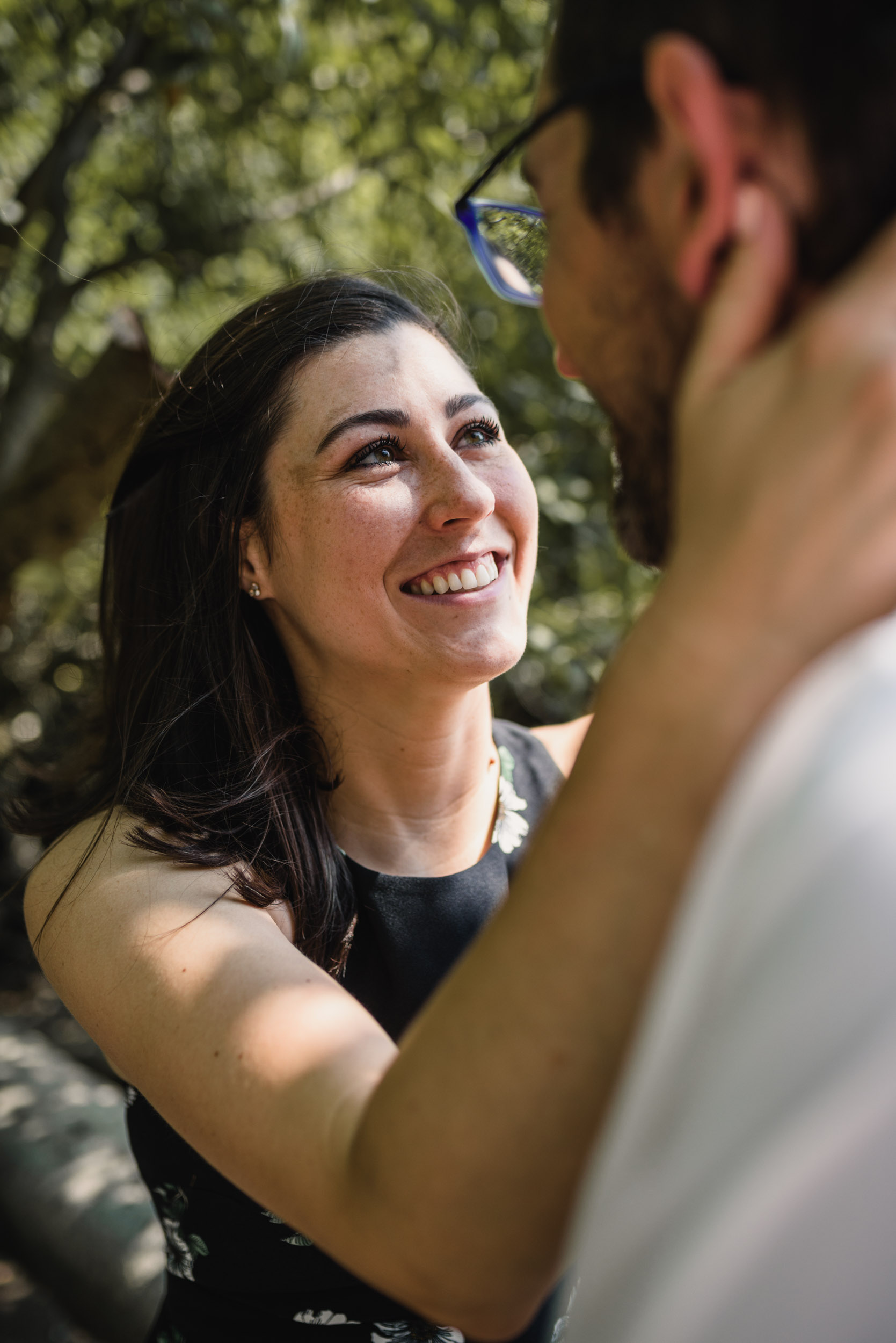 Smiling woman embracing fiancee