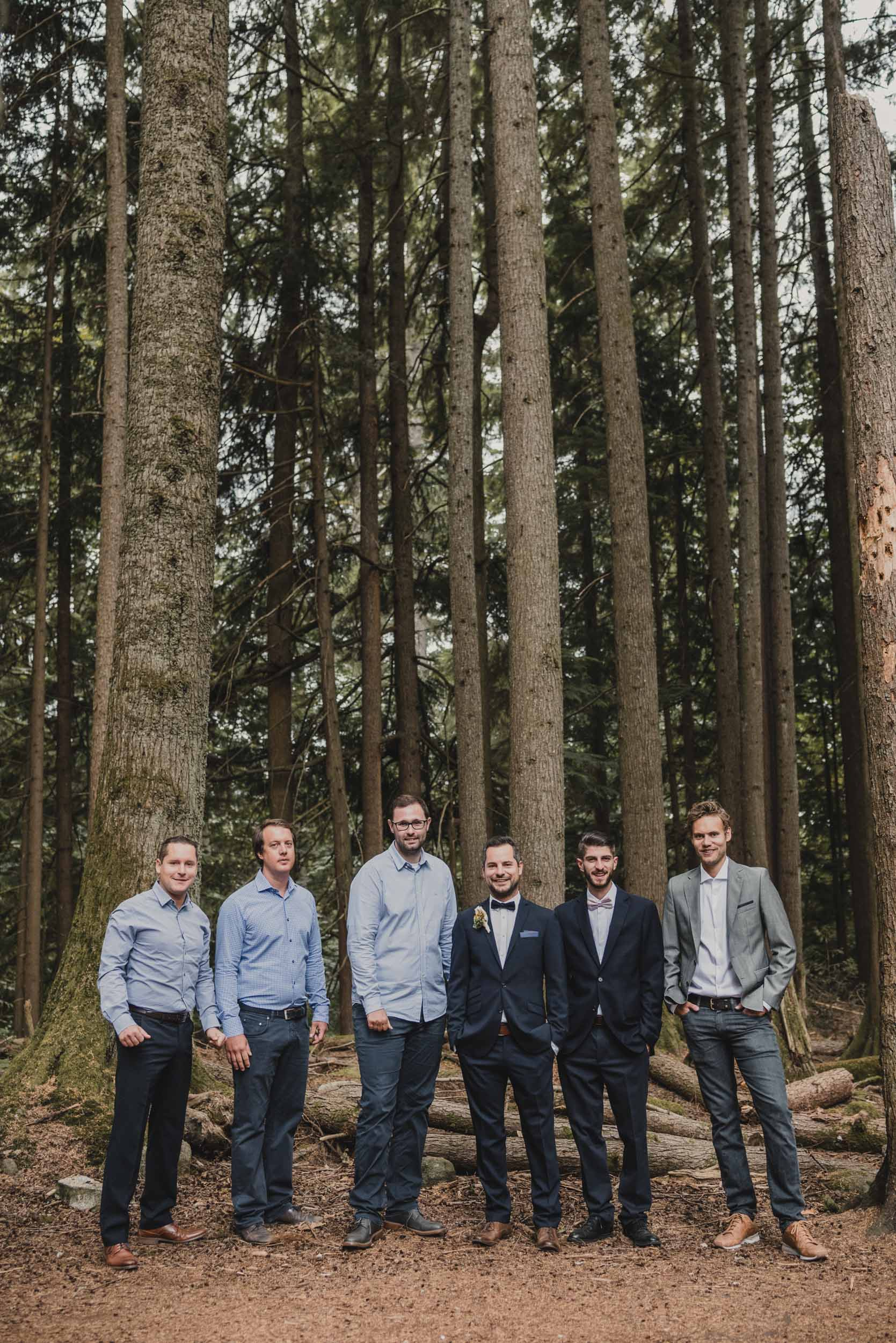 Groom and groomsmen group photo in forest