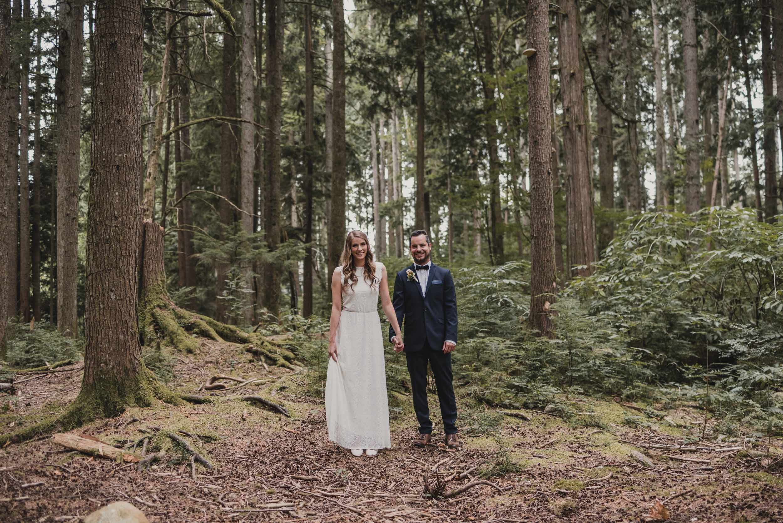 Bride and Groom side by side in forest