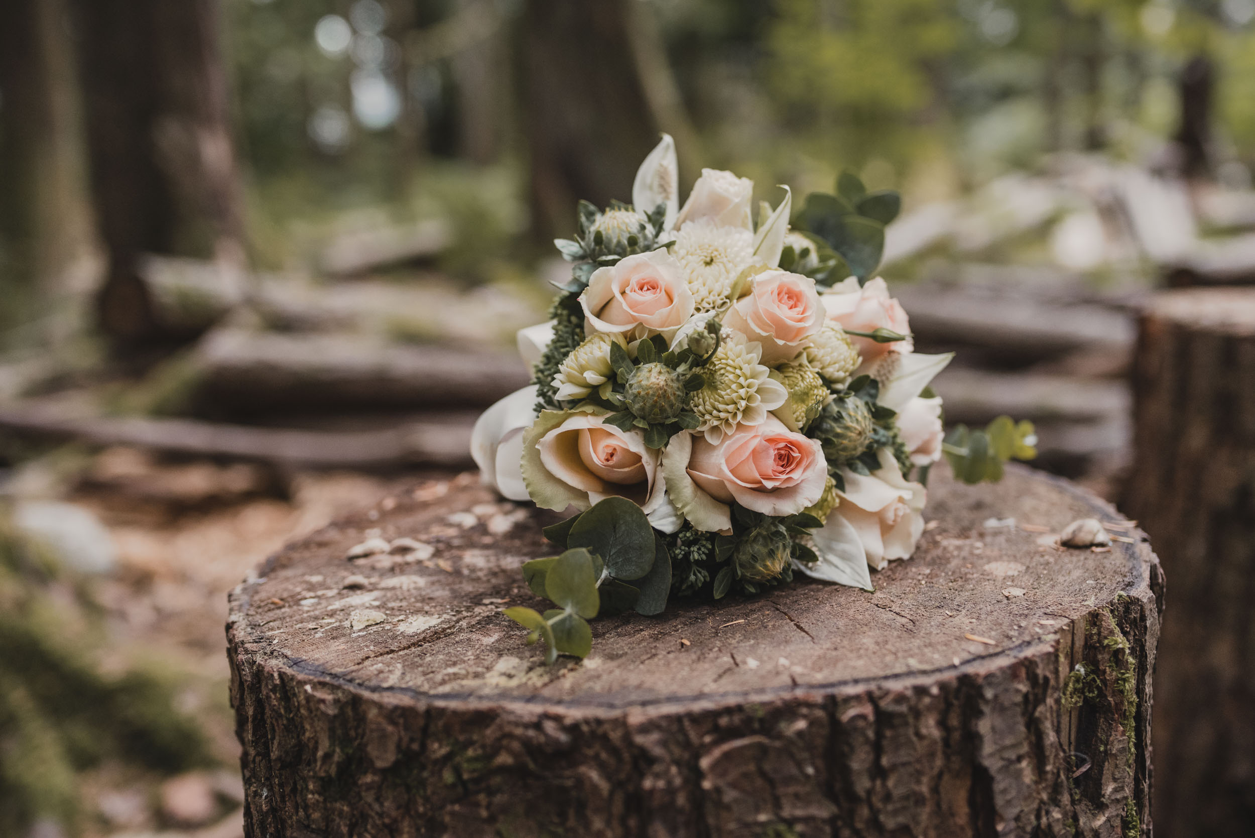 Bridal bouquet on log