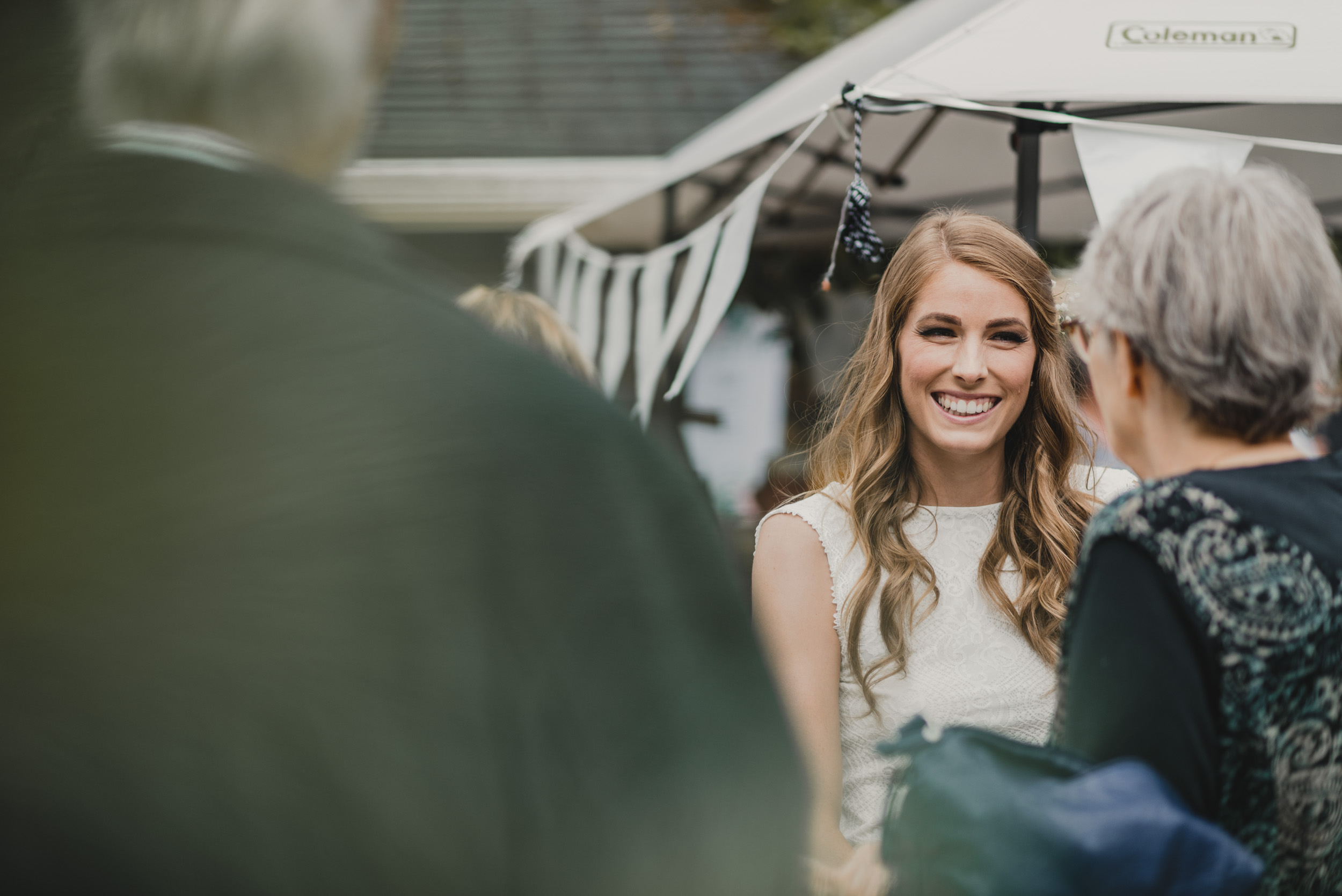 Bride smiling with guests at reception