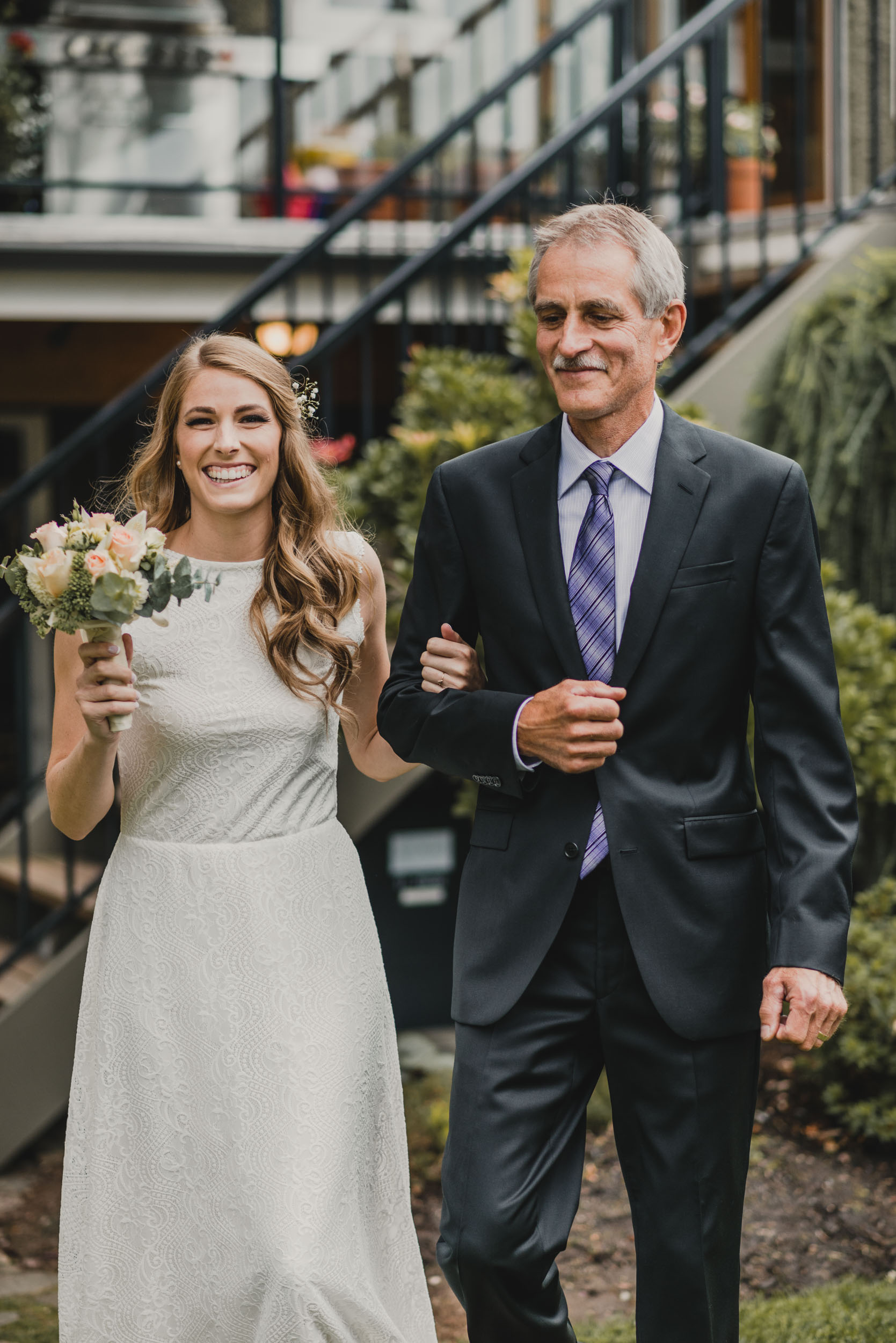 Father of the Bride walks her to altar