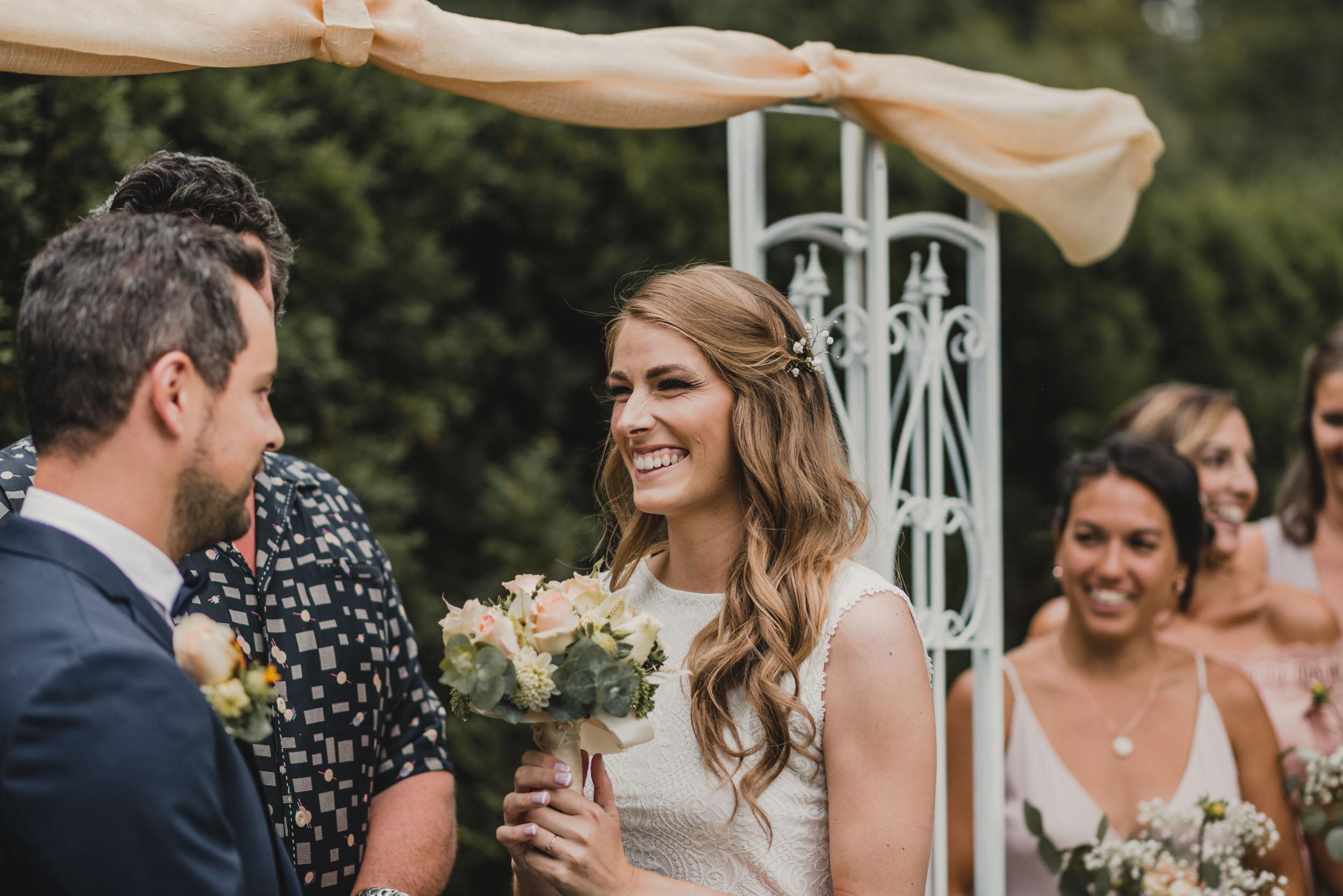 Bride smiling at groom at altar