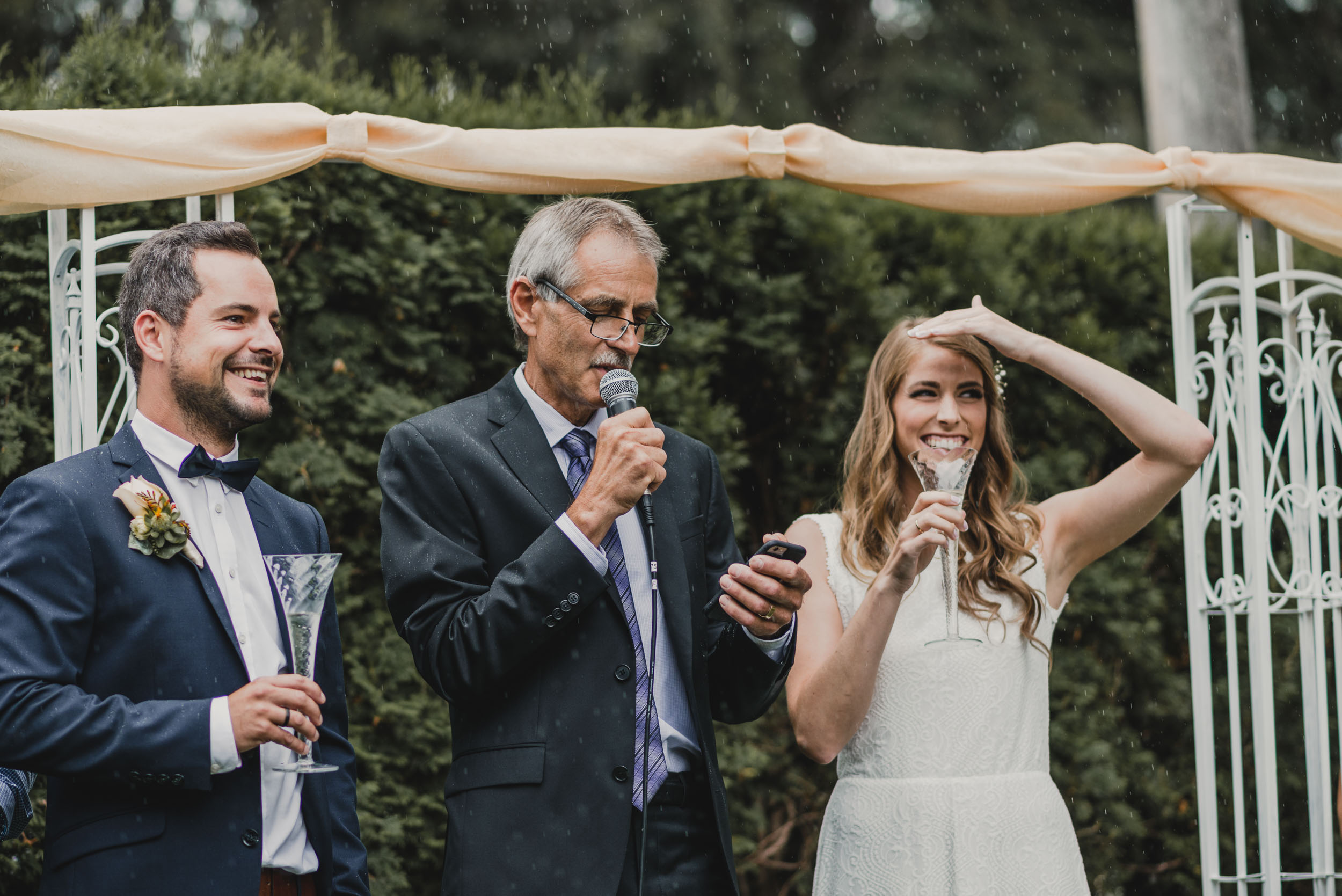 Father of the Bride recites speech during rain