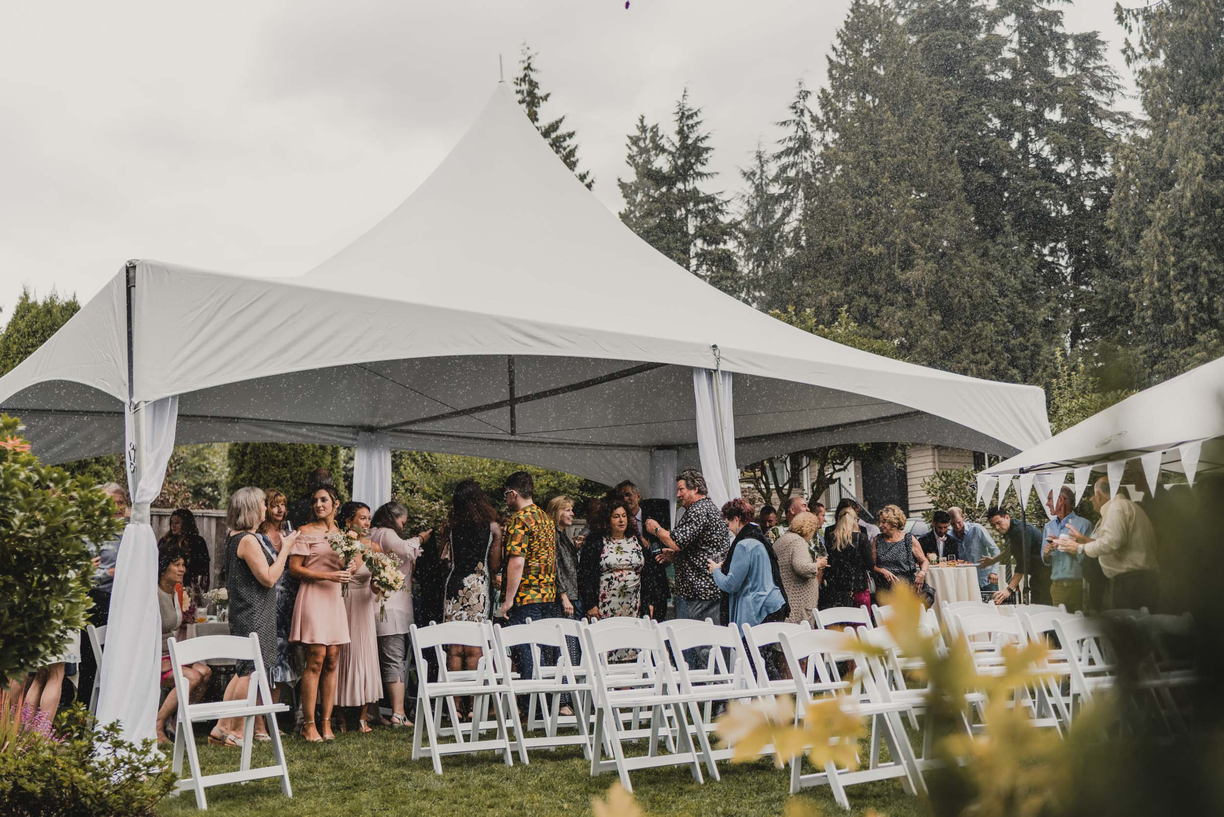 Wedding guests hiding from rain