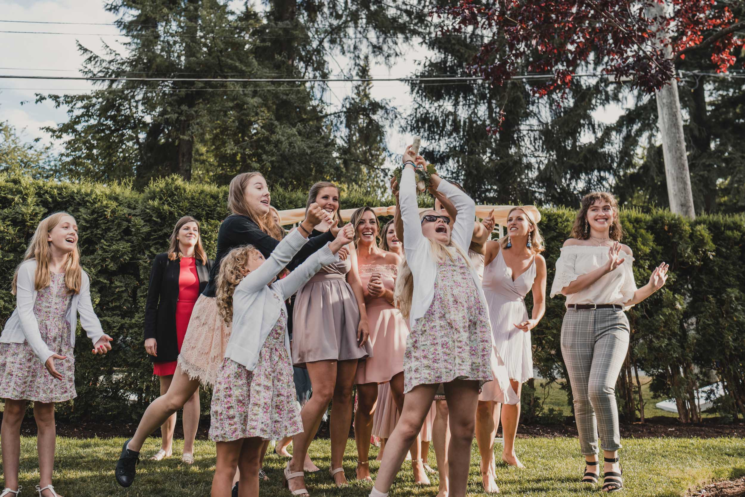 Young guest catches bouquet
