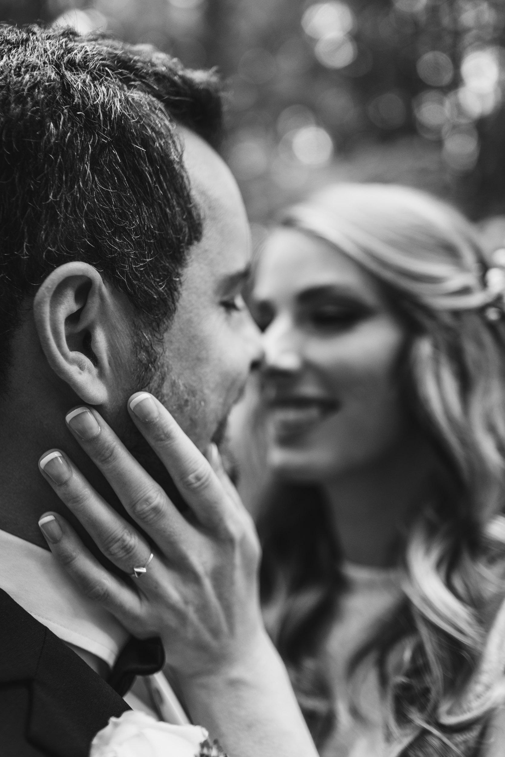 Bride's hand on Groom's cheek