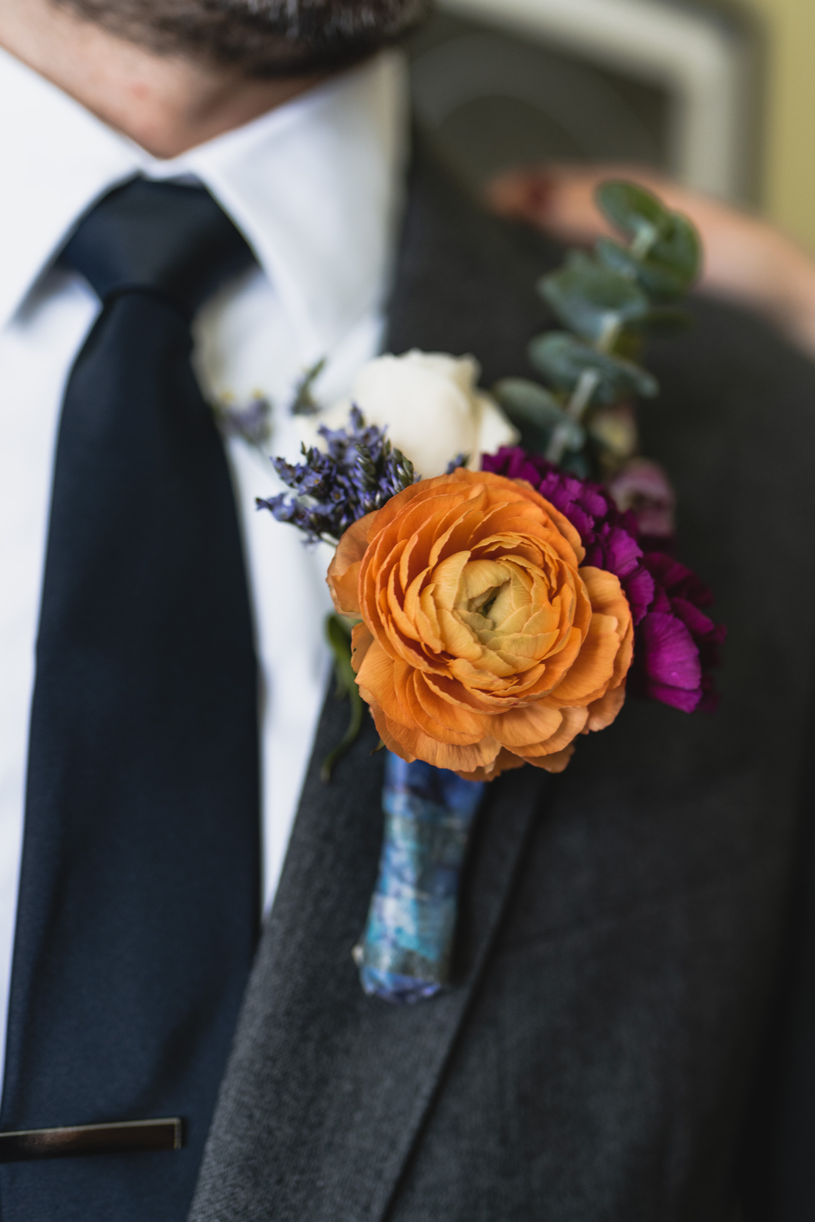 Groom orange boutonnière